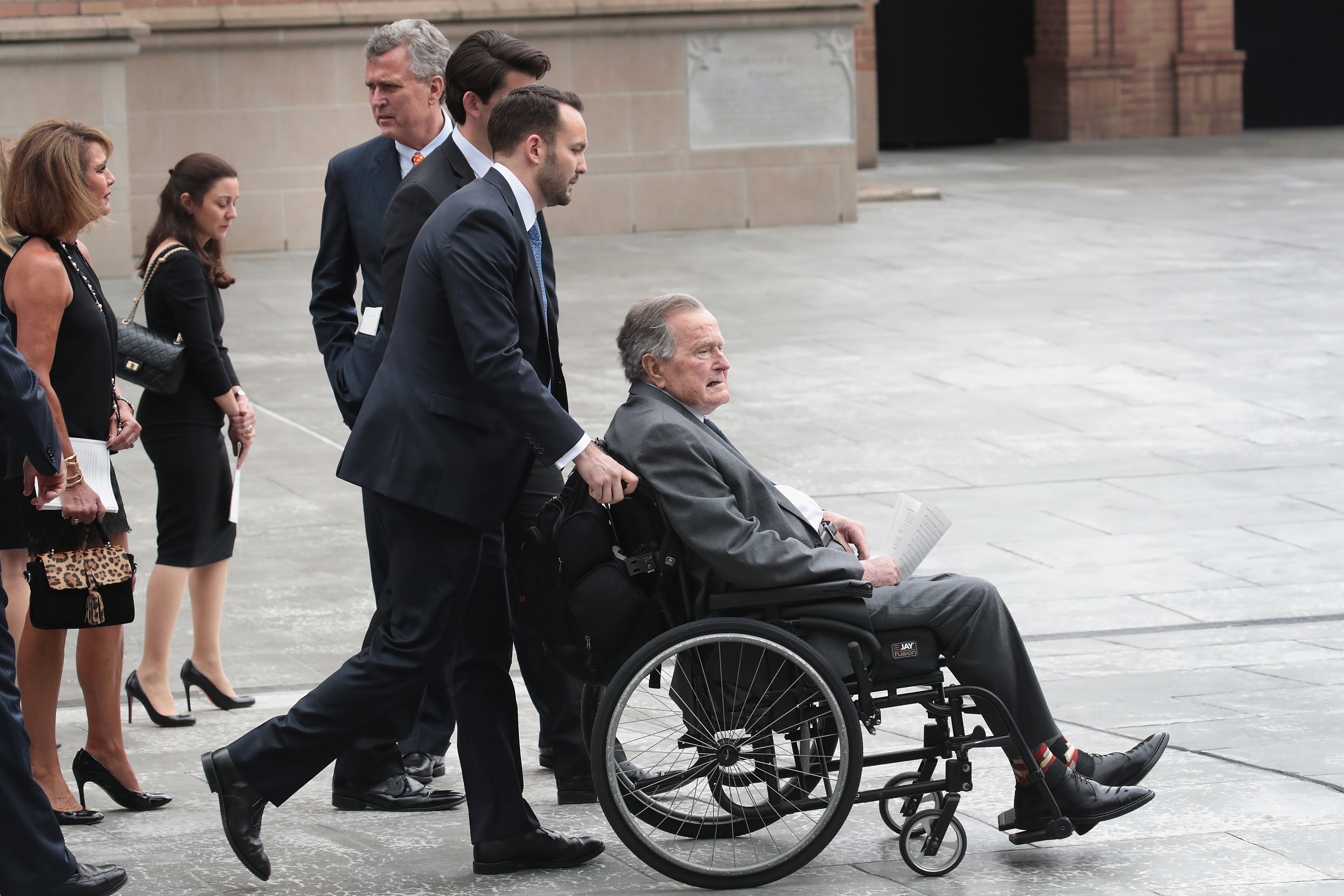 Former president George H.W. Bush leaves the funeral service of former first lady Barbara Bush at St. Martin's Episcopal Church on April 21, 2018 in Houston, Texas.
