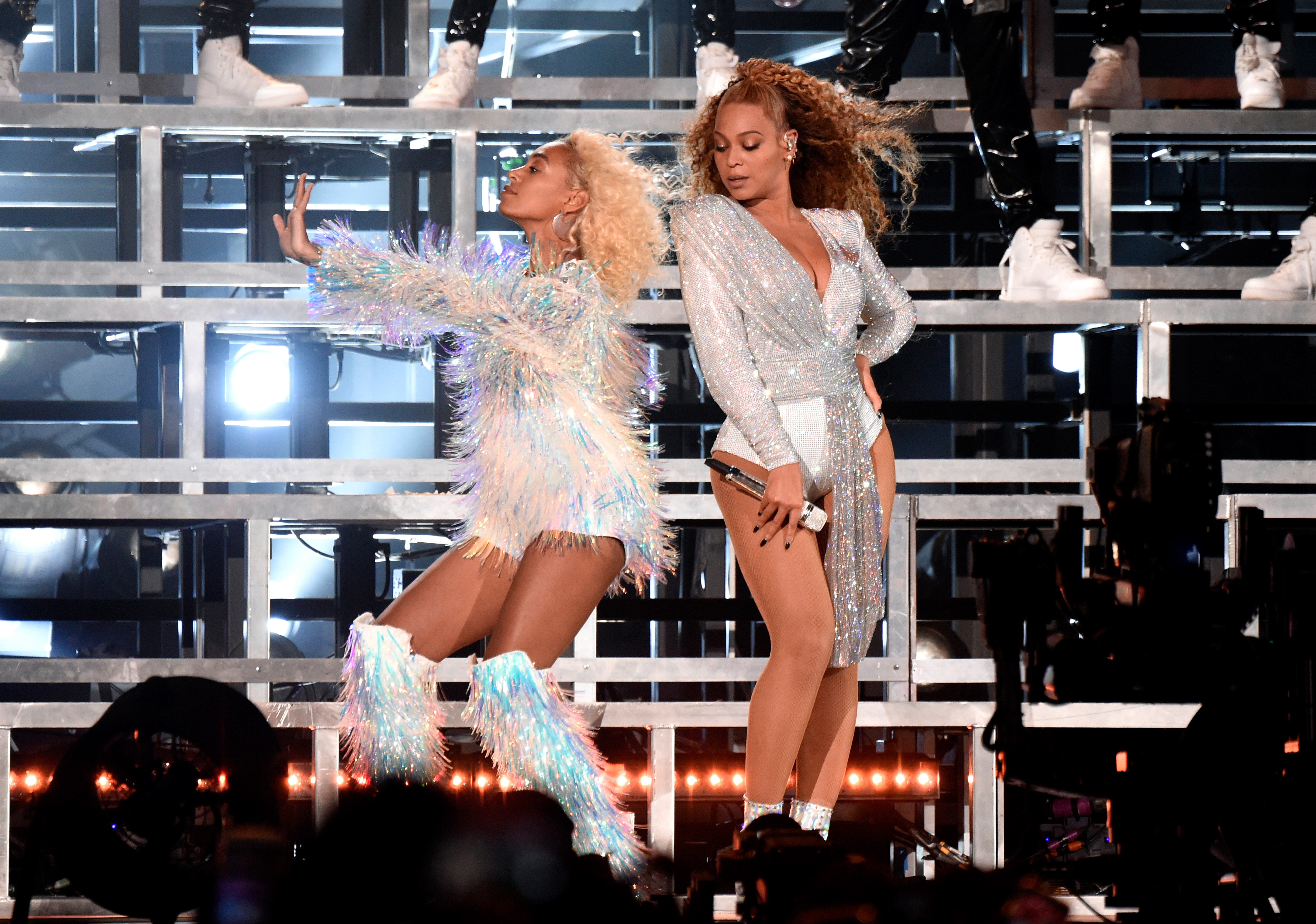 INDIO, CA - APRIL 21:  Solange Knowles (L) and Beyonce Knowles perform onstage during the 2018 Coachella Valley Music And Arts Festival at the Empire Polo Field on April 21, 2018 in Indio, California.  (Photo by Kevin Mazur/Getty Images for Coachella)