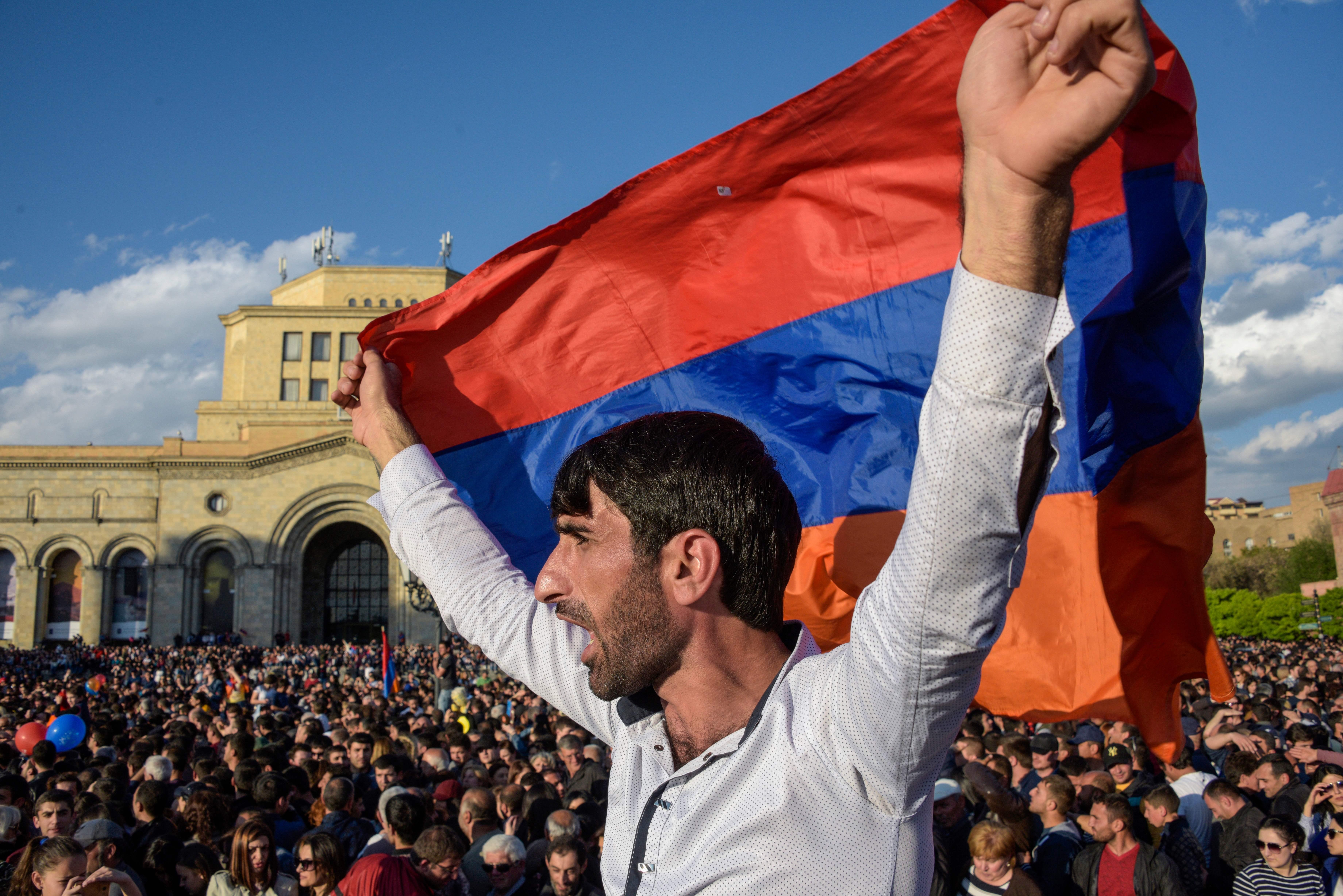 People celebrate Armenian prime minister Serzh Sarkisian's resignation in downtown Yerevan on April 23, 2018.