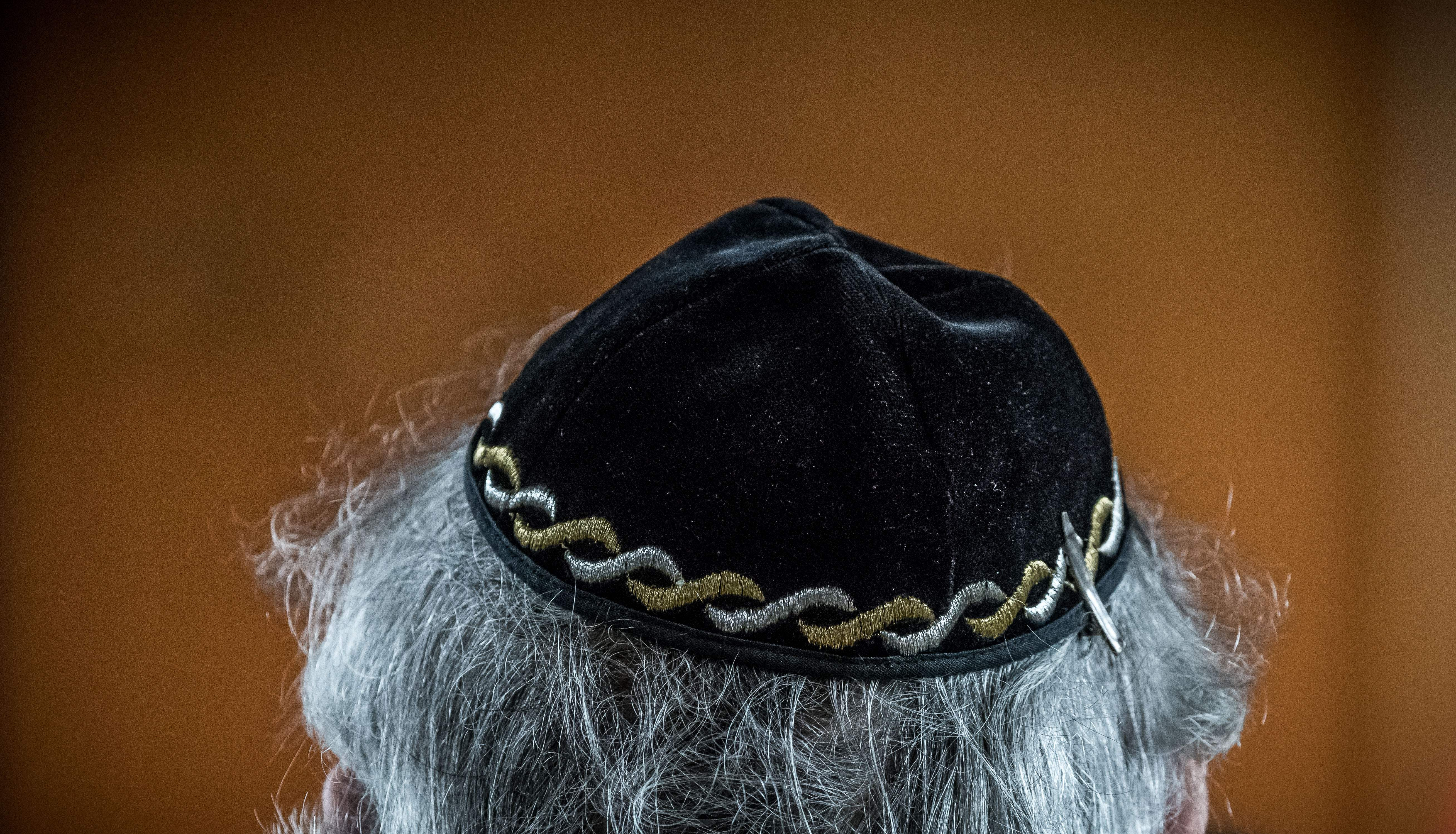 A Jewish man wears a kippa, or Jewish religious skull cap, during a meeting on  the German and French perspectives on immigration, integration and identity  organized by the American Jewish Committee (AJC) in Berlin on April 24, 2018.