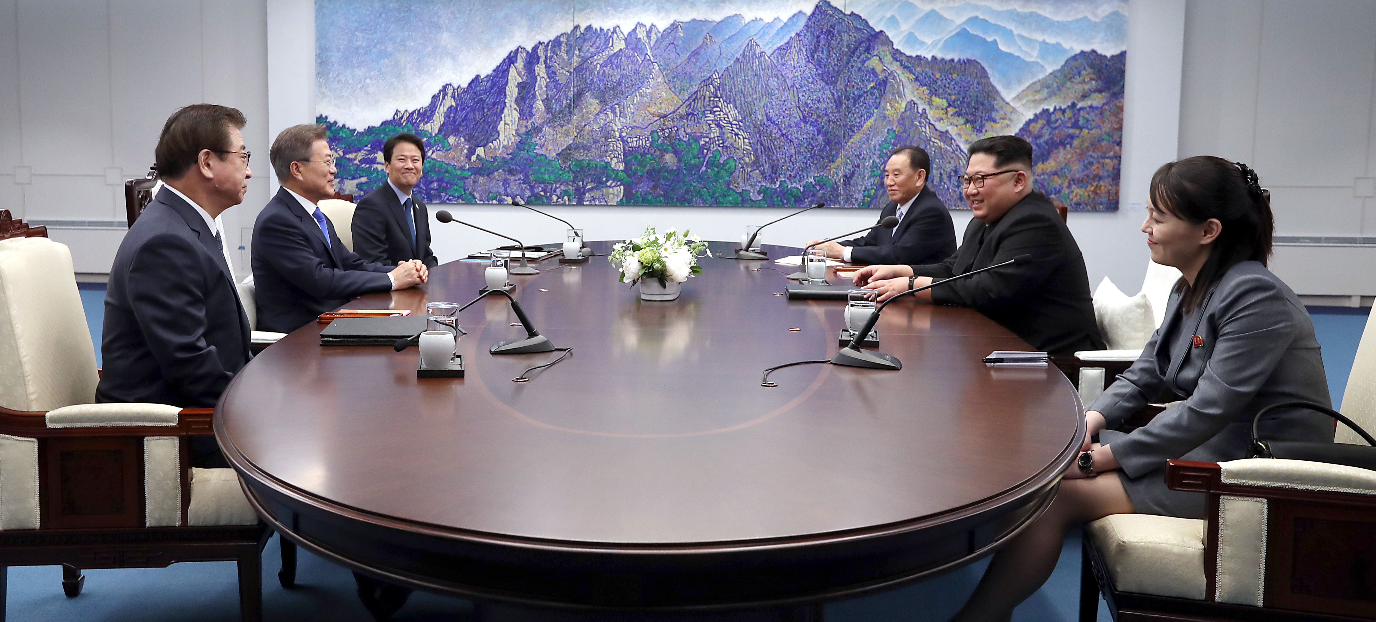 South Korean delegation including President Moon Jae-in and North Korean delegation including Leader Kim Jong Un sit down for the Inter-Korean Summit at the Peace House on April 27, 2018.
