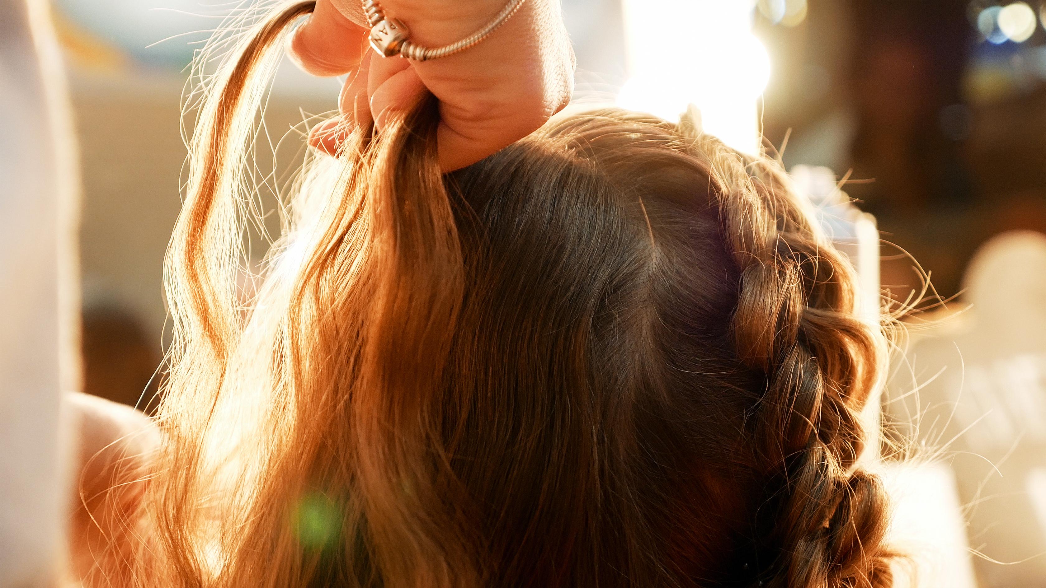 Hair braiding bus driver