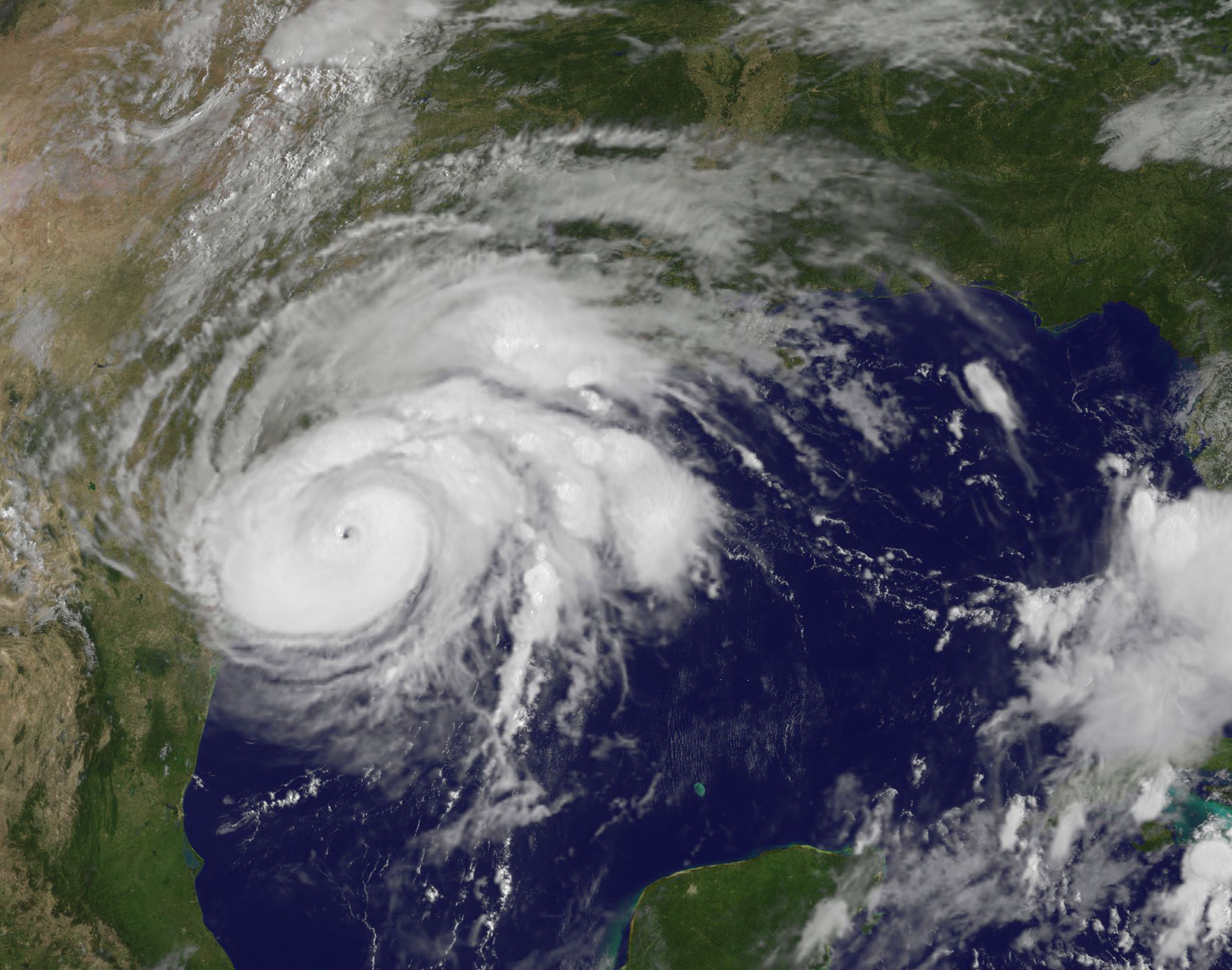 In this NOAA handout image, NOAA's GOES East satellite capture of Hurricane Harvey shows the storm's eye as the storm nears landfall on Aug. 25, 2017 in the southeastern coast of Texas.