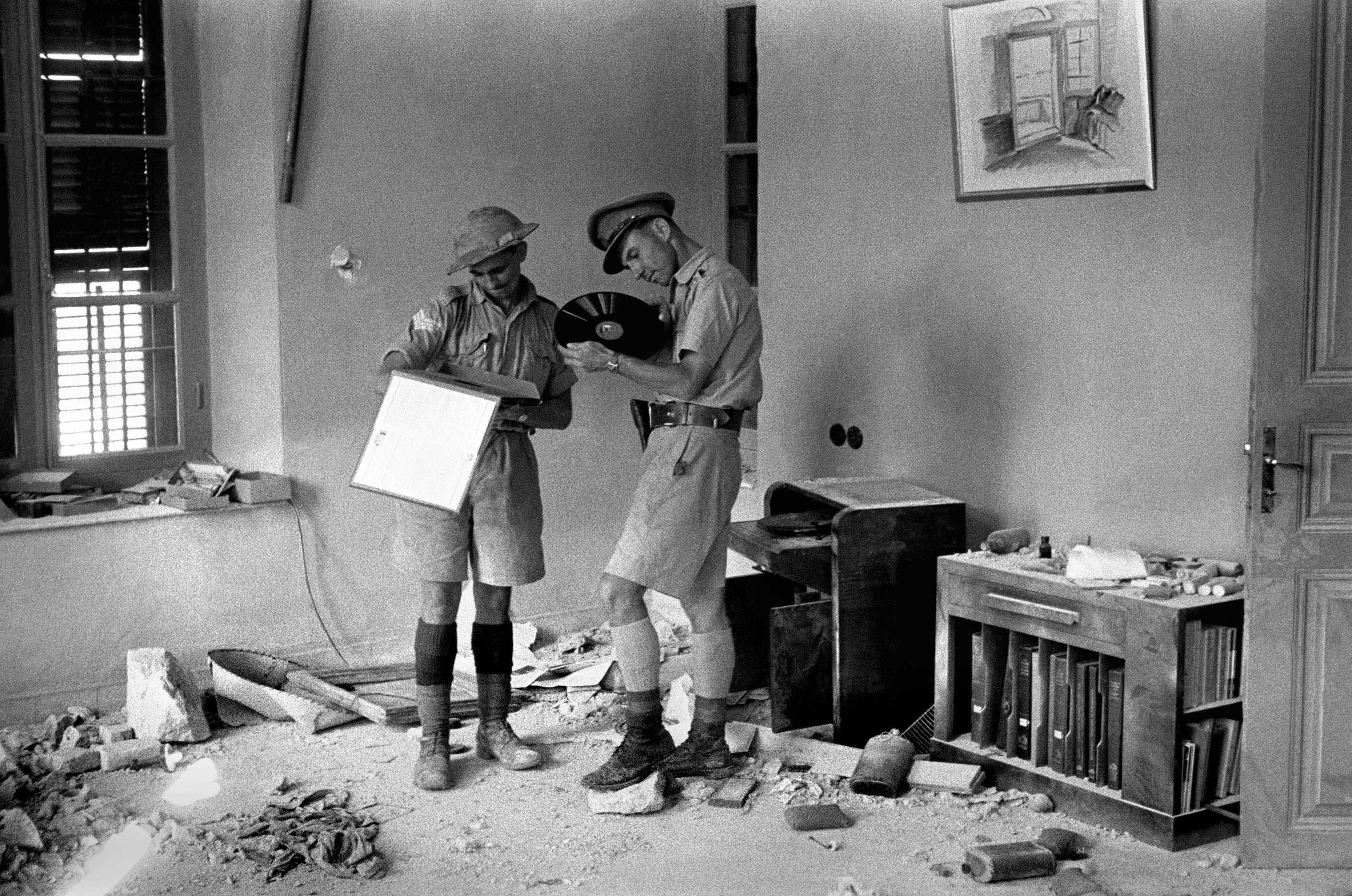 Officers of the Indian Army discover the Vichy French headquarters after the surrender in Damascus, Syria, 1941.