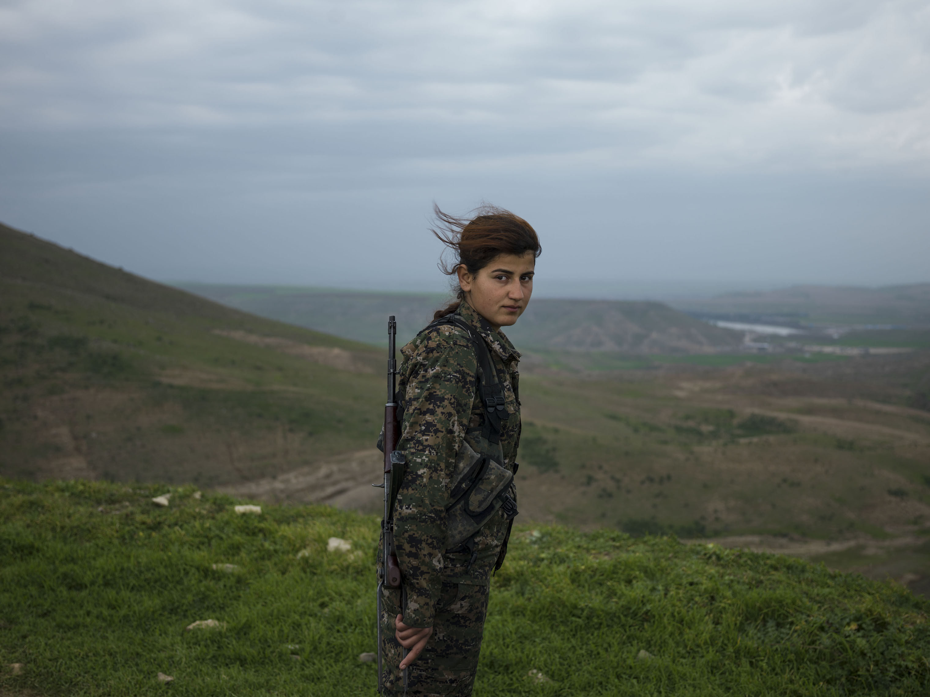 I joined YPJ about seven months ago, because I was looking for something meaningful in my life and my leader [Ocalan] showed me the way and my role in the society. We live in a world where women are dominated by men. We are here to take control of our own future. We are not merely fighting with arms; we fight with our thoughts. Ocalan's ideology is always in our hearts and minds and it is with his thought that we become so empowered that we can even become better soldiers than men. When I am at the frontline, the thought of all the cruelty and injustice against women enrages me so much that I become extra-powerful in combat. I injured an ISIS jihadi in Kobane. When he was wounded, all his friends left him behind and ran away. Later I went there and buried his body. I now feel that I am very powerful and can defend my home, my friends, my country, and myself. Many of us have been martyred and I see no path other than the continuation of their path.  Torin Khairegi, 18, in Zinar base, Rojava, Syria.