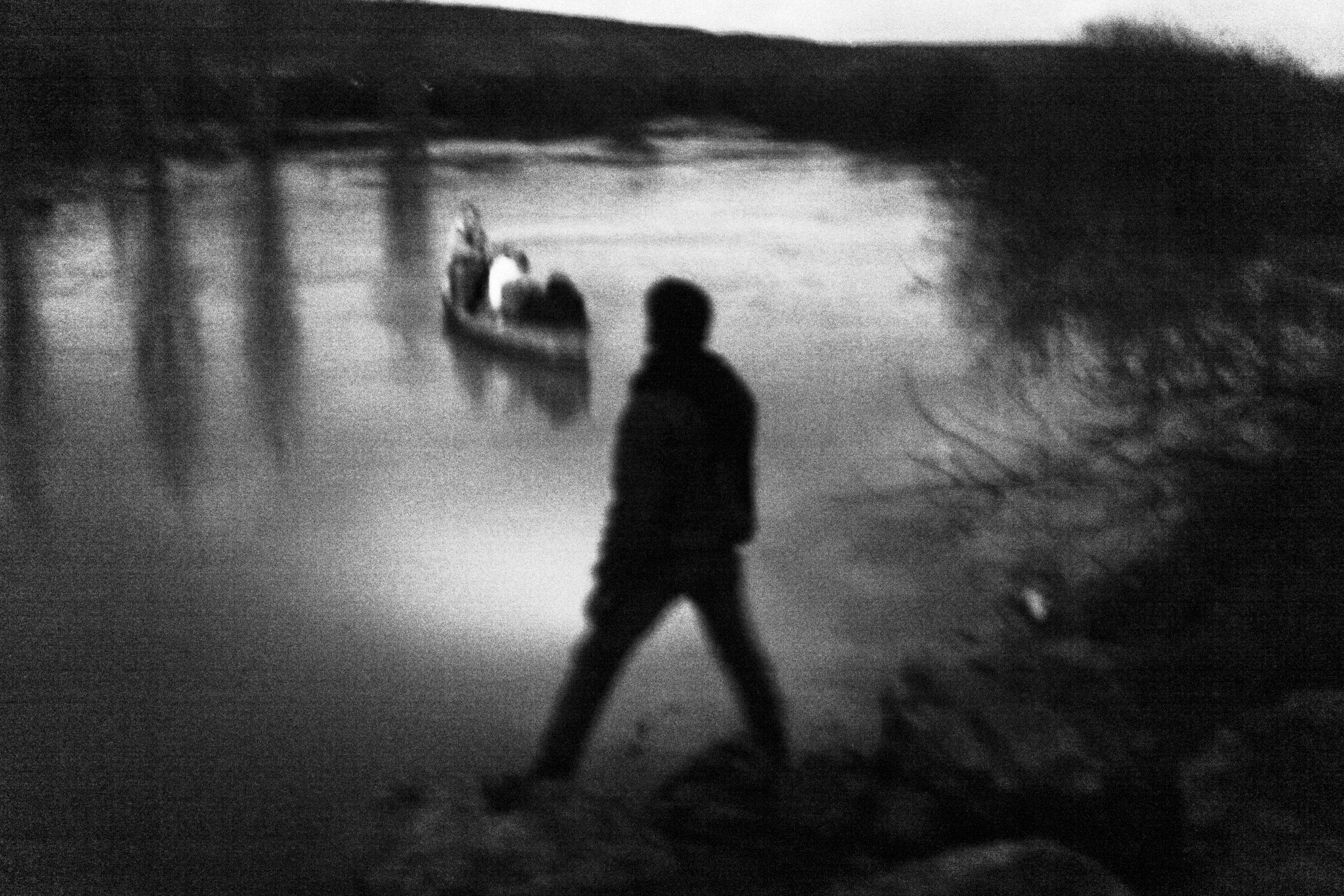 Along the Turkish-Syrian border under the cover of night, a network of Syrian smugglers transport a family fleeing the violence inside Syria on a rowboat across the Orontes River, which marks a stretch of the border between northern Syria and southern Turkey.