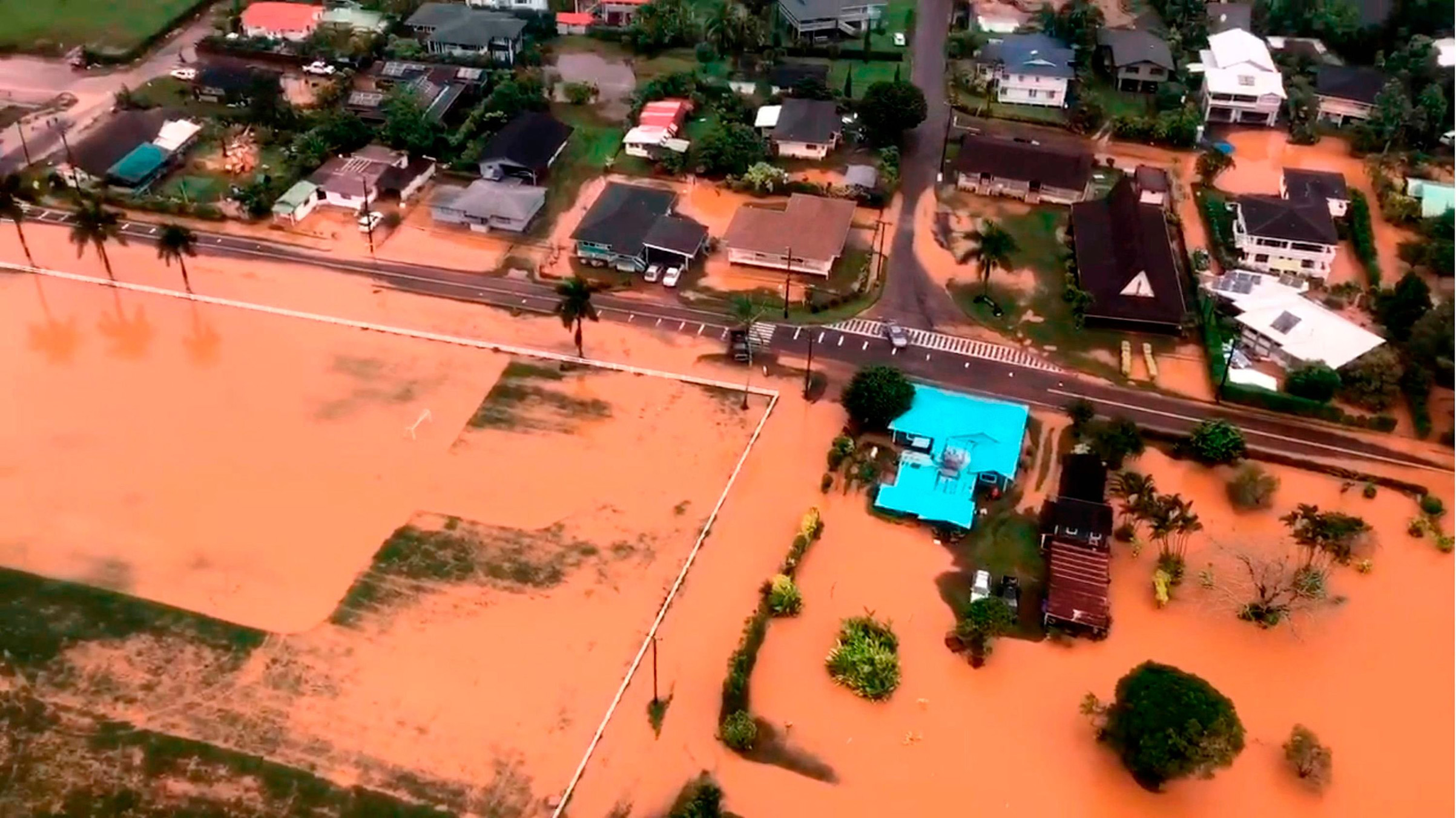 This image taken from video provided by the U.S. Coast Guard shows flooding along Kauai's Hanalei Bay, Hawaii on April 15, 2018.