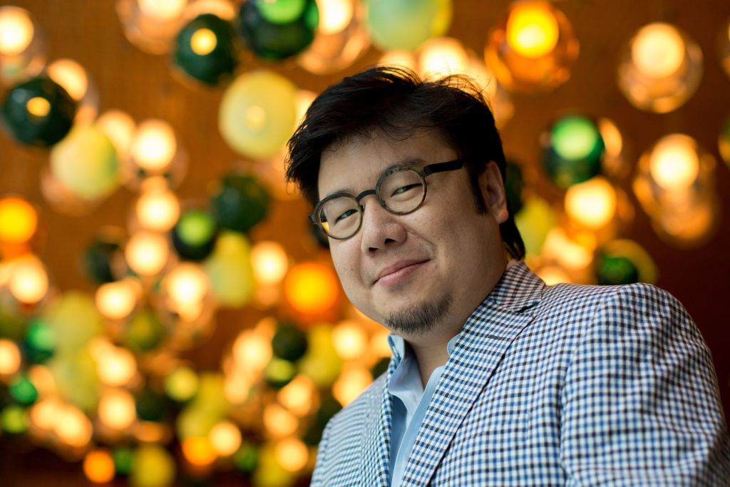Author Kevin Kwan poses in the lobby of the Shangri-La hotel