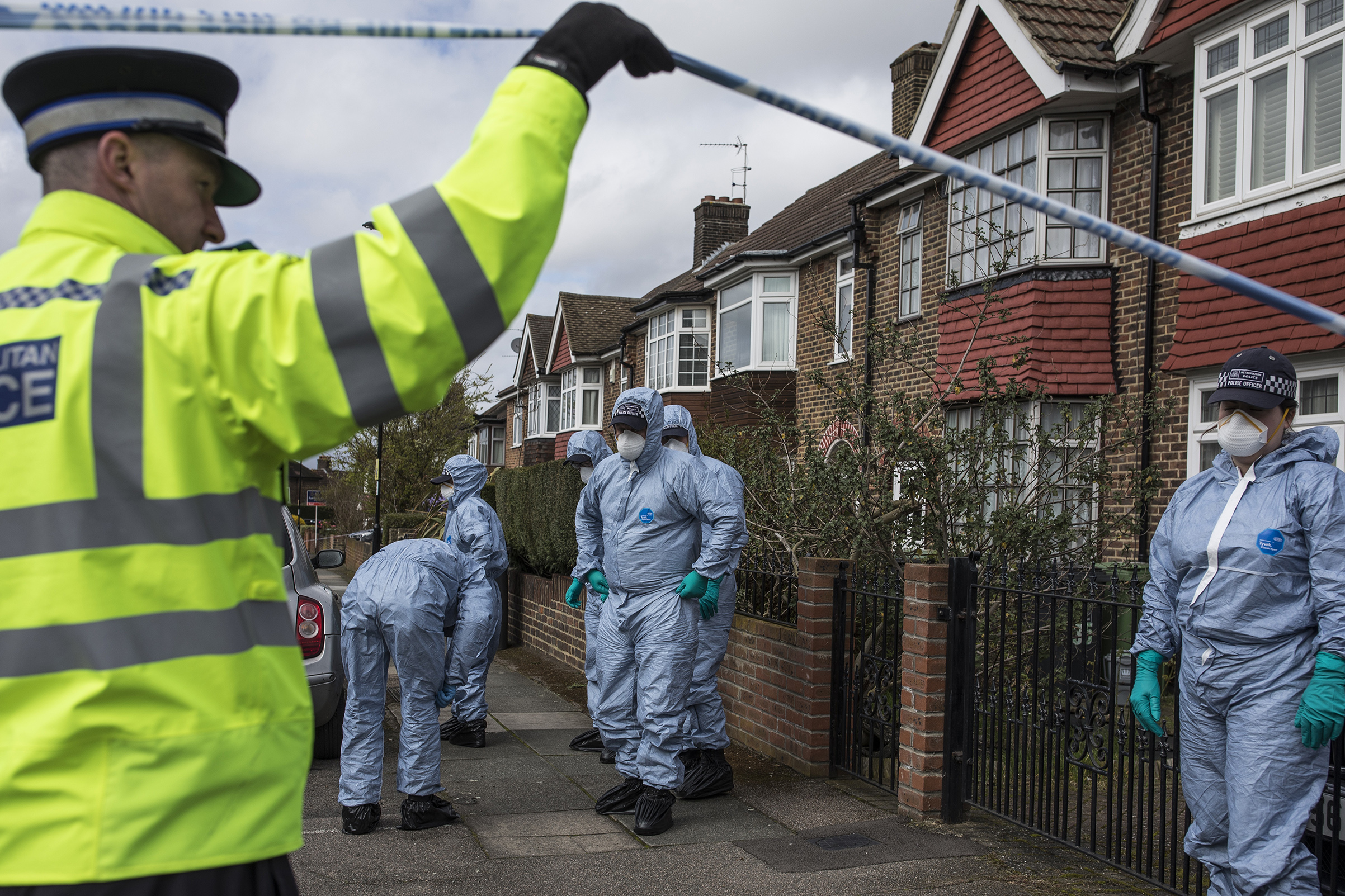 A forensics team searches a street where a man died after a robbery on April 4 in London;                      there were more murders in March in London than in any other month in over a decade
