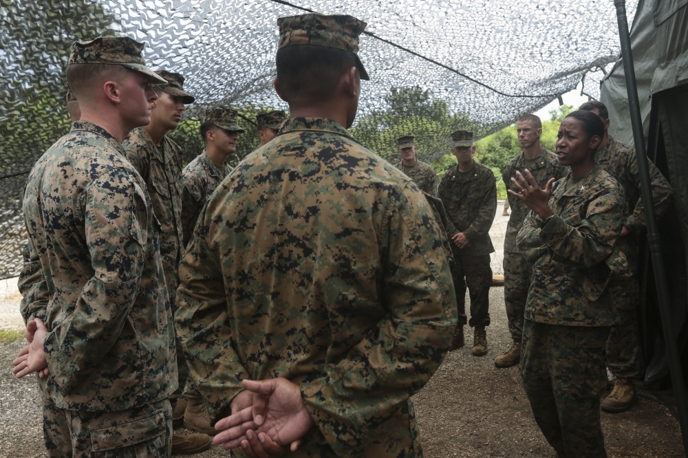 U.S. Marines with Marine Aircraft Control Group 18 listen to Colonel Lorna Mahlock, commanding officer, MACG-18, during Exercise Valiant Shield 16, Sept. 14, 2016
