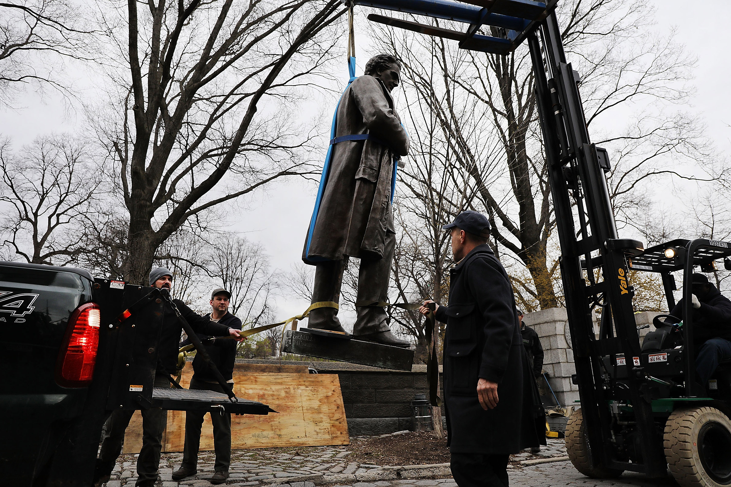 A statue of J. Marion Sims, who was a prominent gynecologist, is loaded onto a New York City Department of Parks & Recreation truck after being taken down from its pedestal bordering Central Park on East 103rd Street on April 17, 2018.