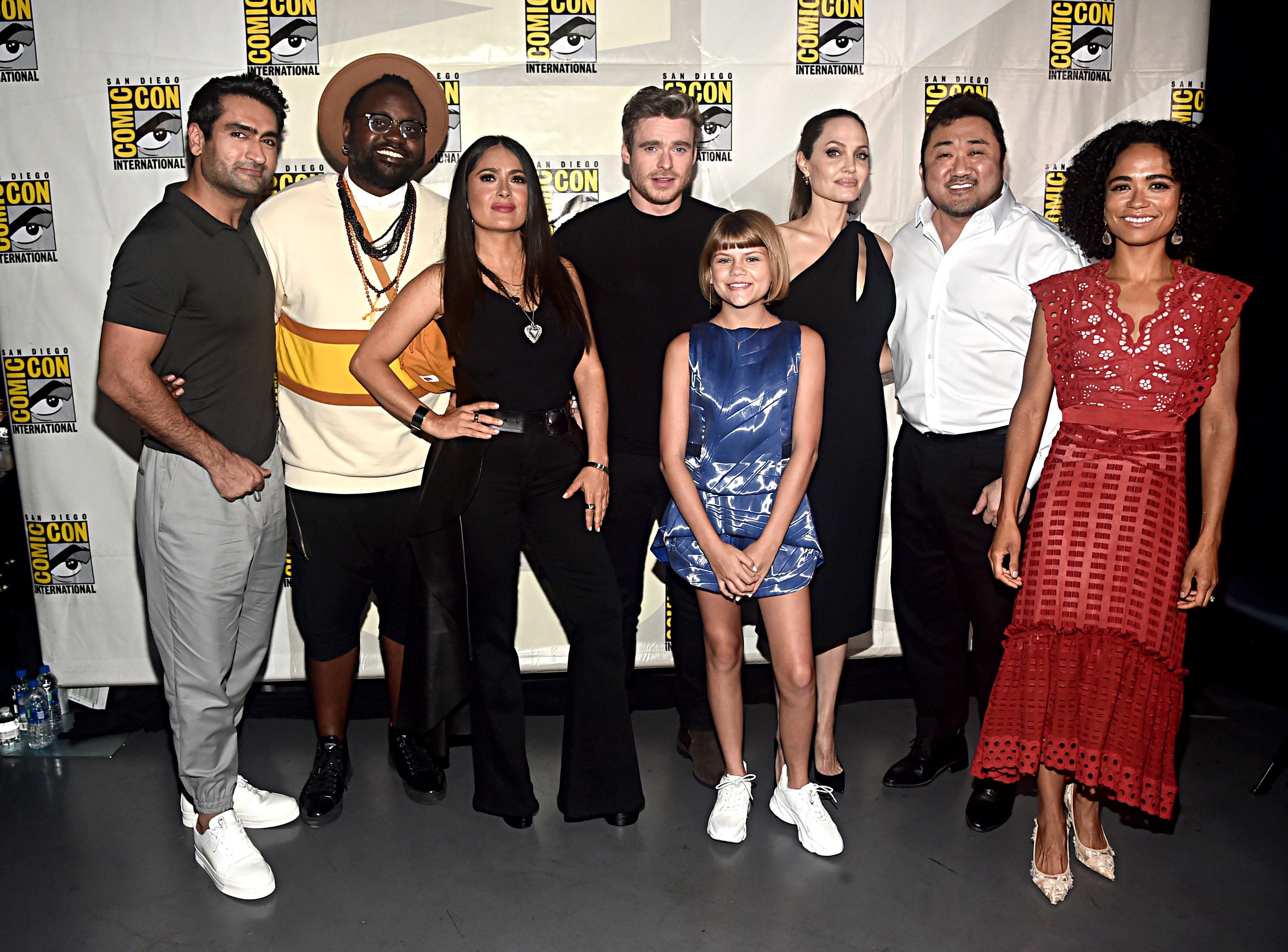 (L-R) Kumail Nanjiani, Brian Tyree Henry, Salma Hayek, Richard Madden, Lia McHugh, Angelina Jolie, Don Lee and Lauren Ridloff of Marvel Studios' 'The Eternals' at the San Diego Comic-Con in 2019.