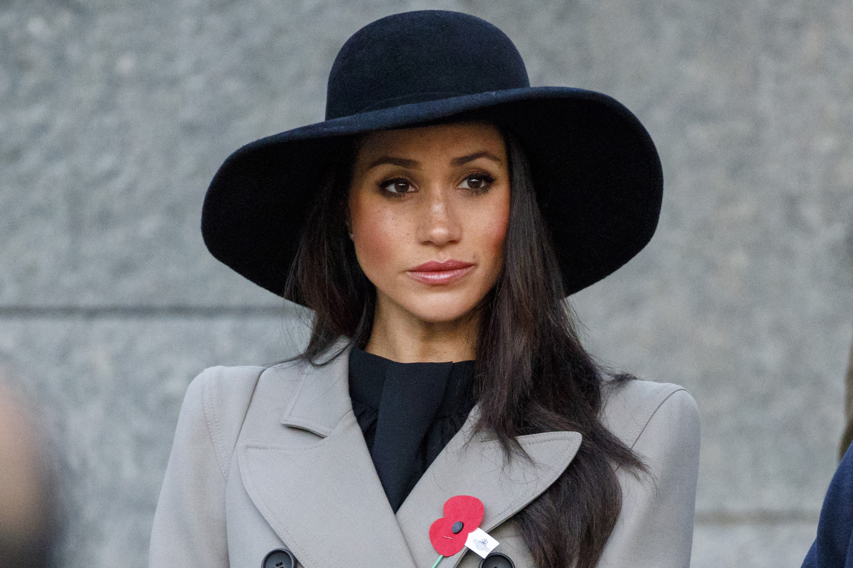 Meghan Markle, the US fiancee of Britain's Prince Harry, attends an Anzac Day dawn service at Hyde Park Corner on April 25, 2018 in London, England.