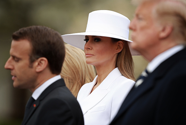 U.S. first lady Melania Trump listens as French President Emmanuel Macron (L) speaks during a state arrival ceremony at the White House with U.S. President Donald Trump April 24, 2018 in Washington, DC.