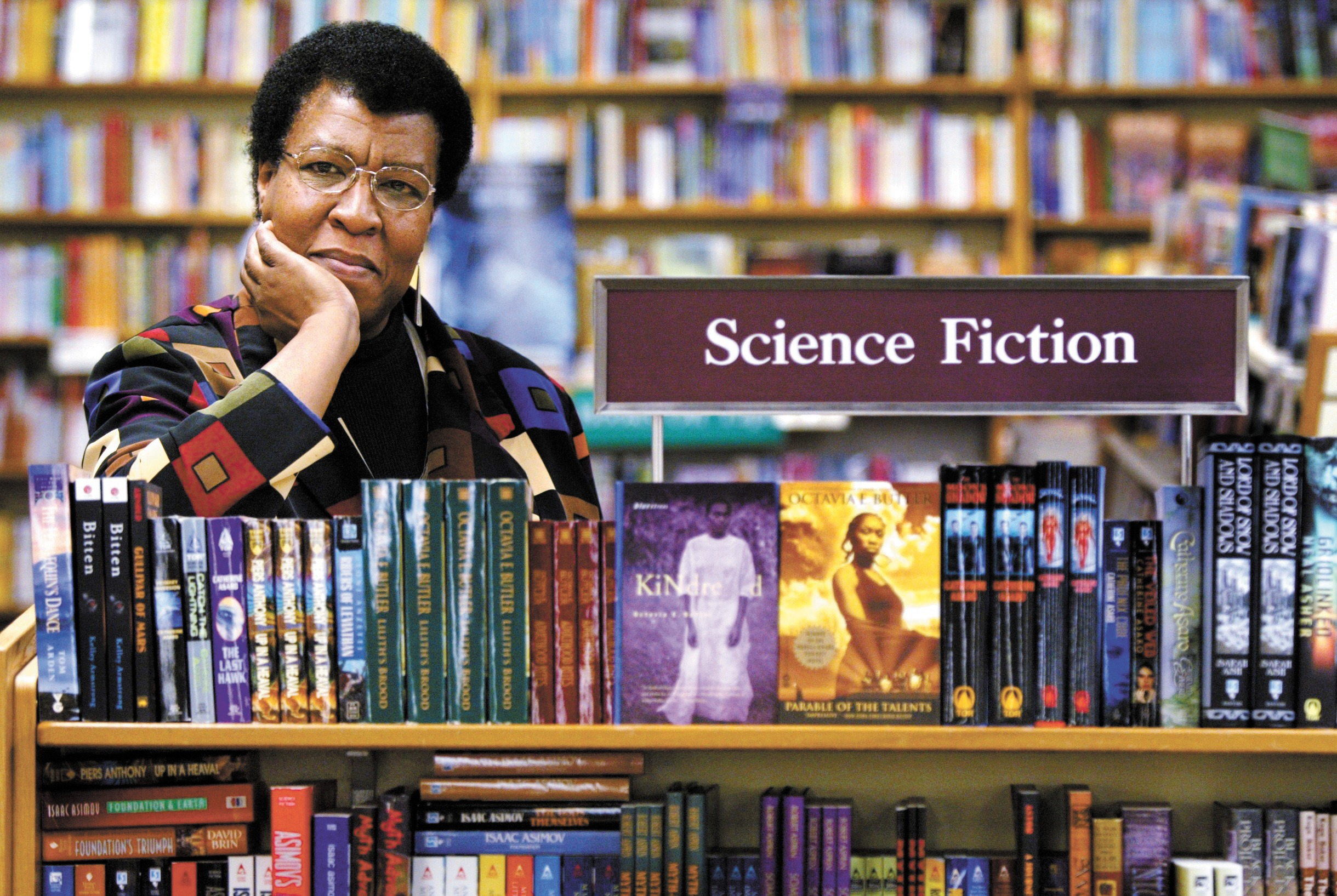 Octavia Butler poses for a photograph near some of her novels at University Book Store in Seattle, Wash., on Feb. 4, 2004.
