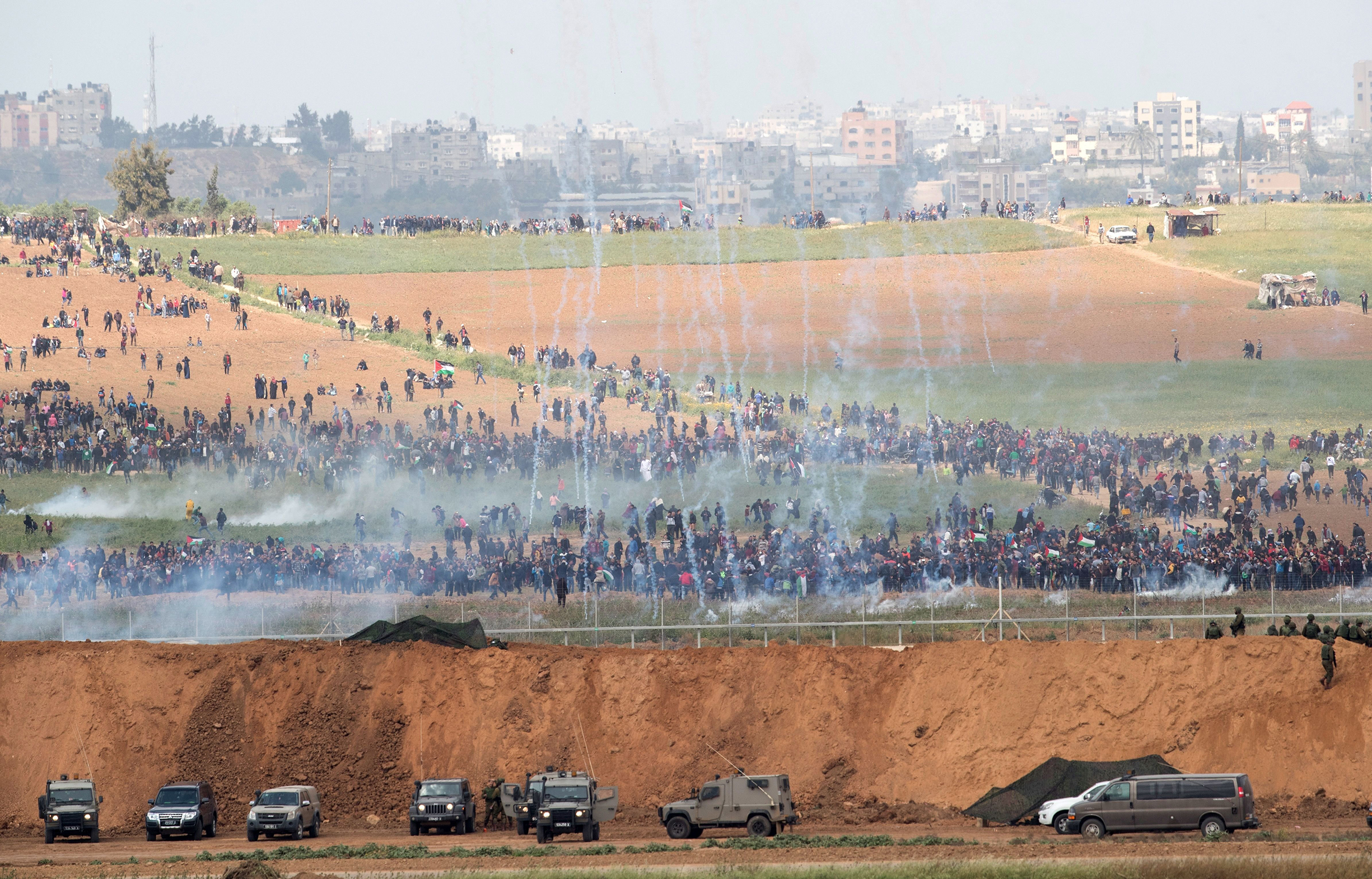 Israeli troops fire tear gas at Palestinian protesters on March 30