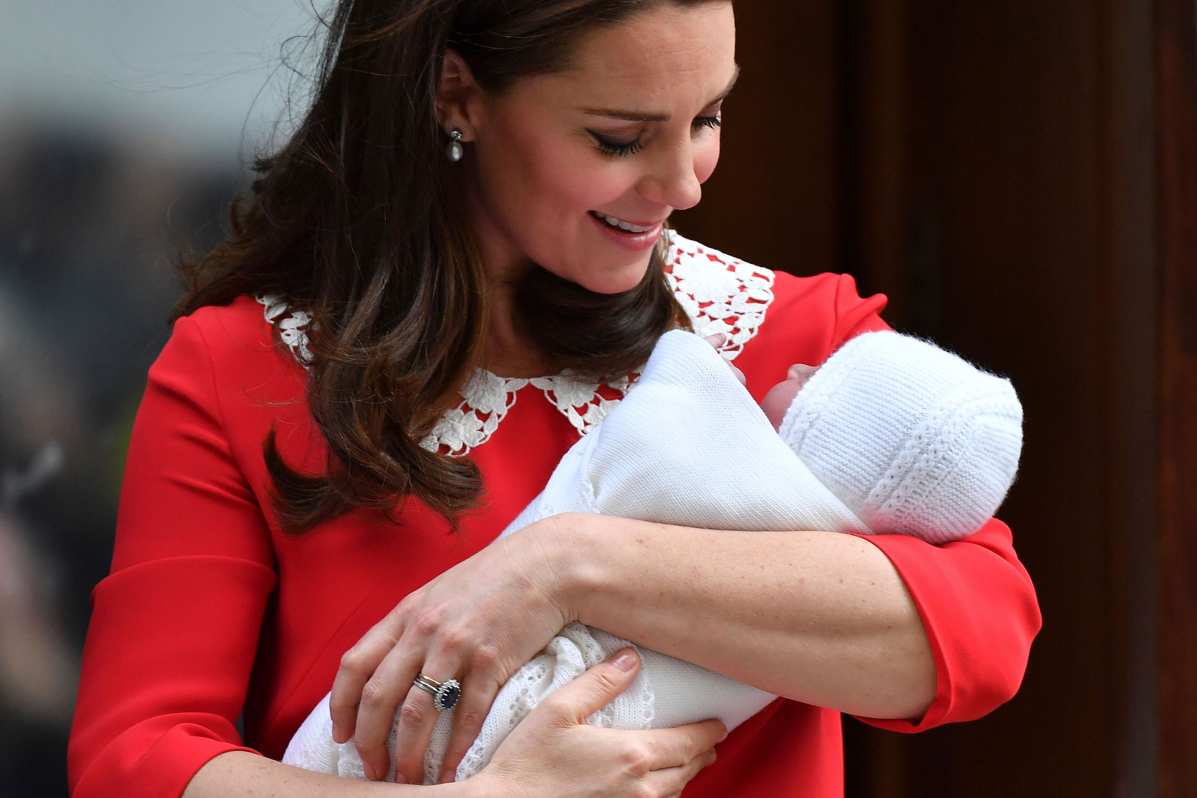 Britain's Catherine, Duchess of Cambridge aka Kate Middleton looks at her newly-born son, her third child, Britain's Prince Louis of Cambridge on the steps of the Lindo Wing at St Mary's Hospital in central London, on April 23, 2018.