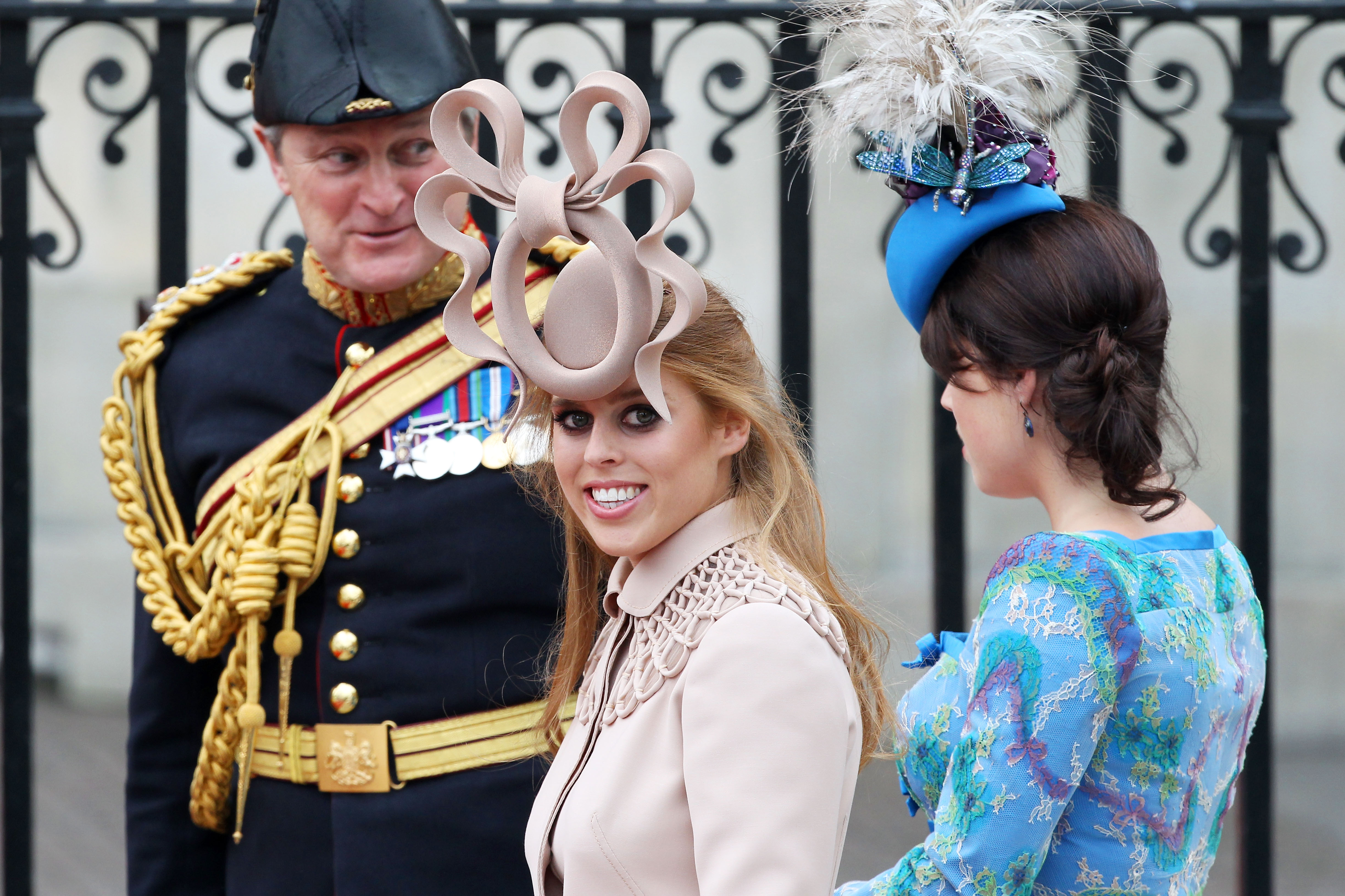 Princess Beatrice of York (L) with her sister Princess Eugenie of York arrive at the Royal Wedding of Prince William to Kate Middleton at Westminster Abbey on April 29, 2011 in London, England.
