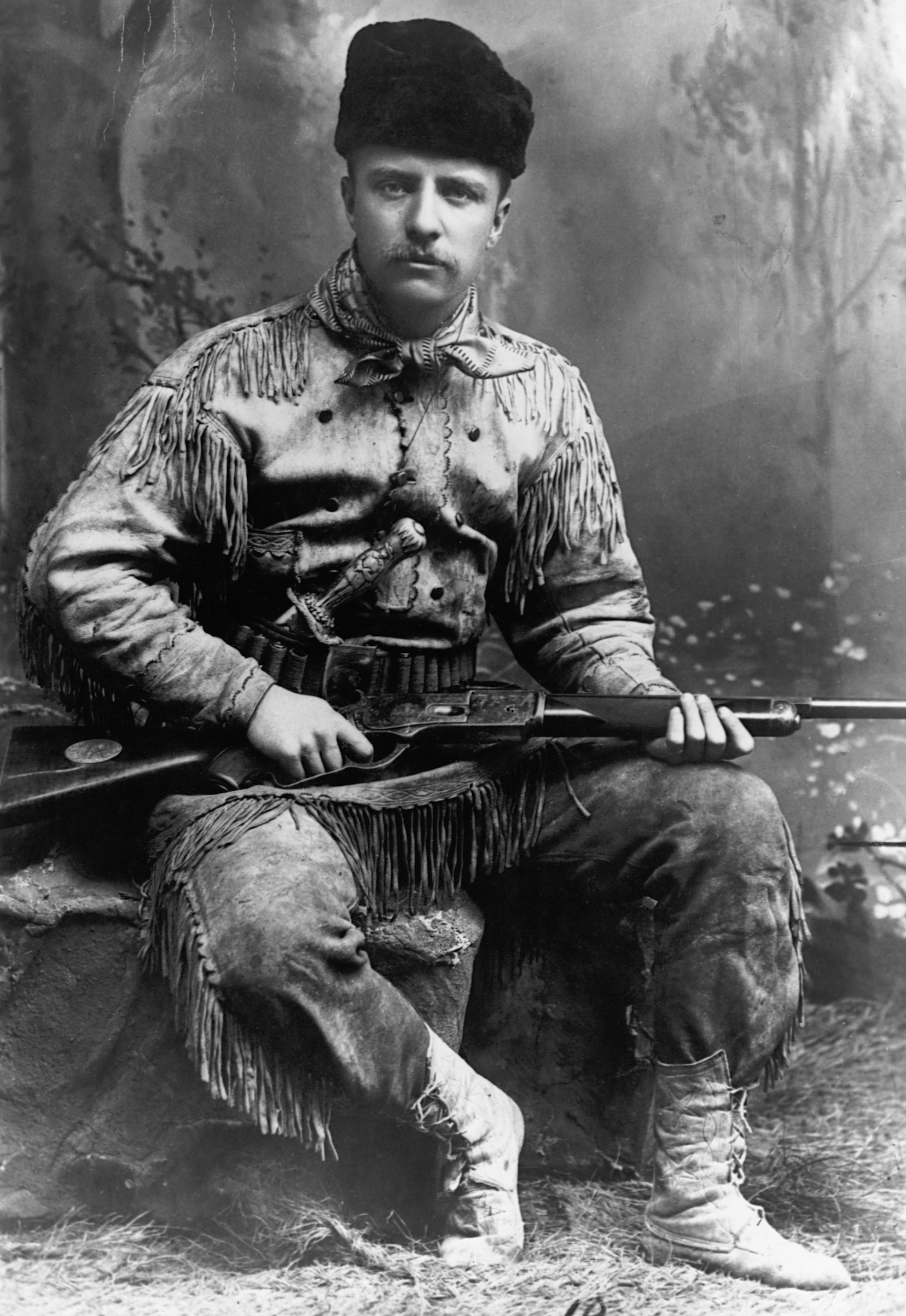 A portrait of Theodore Roosevelt (1858-1919) in buckskin, without his trademark glasses. This portrait is dated 1885, the year he retired to his ranch in the Dakota Territory, following the death of his mother and first wife.