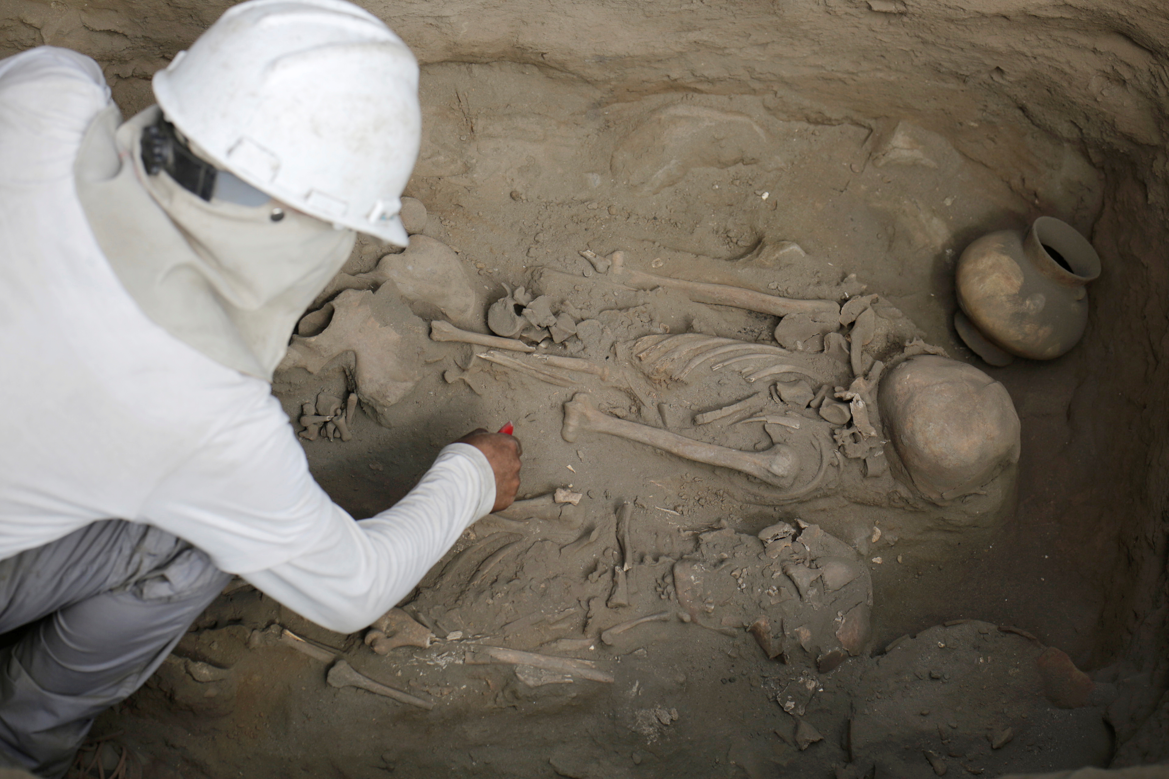 Archaeologists unearth tombs and human remains from the Chimu culture in Trujillo, Peru, on March 21, 2018. Recent discoveries have led to new understandings about the site