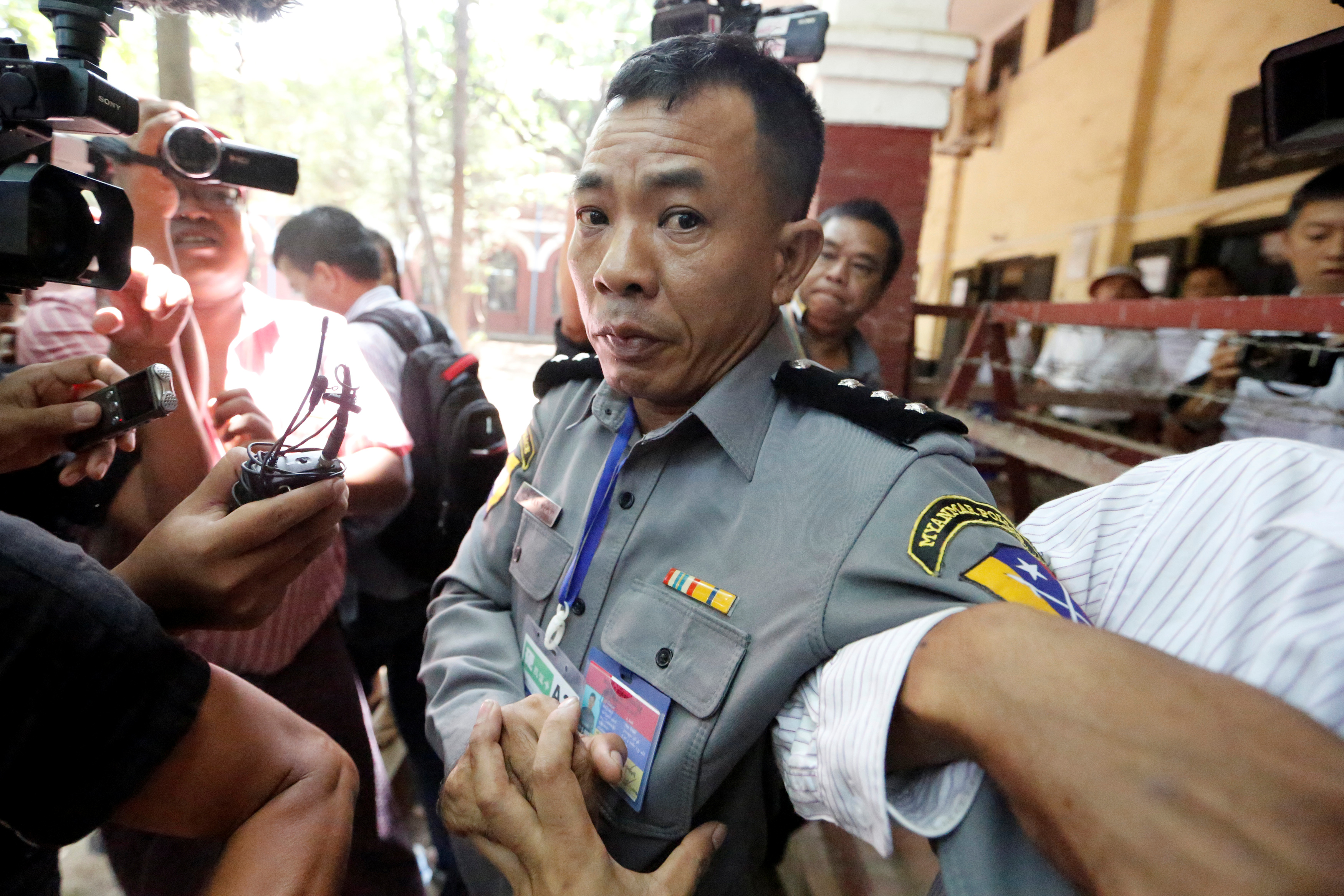 Police captain Moe Yan Naing outside the court room during a hearing of detained Reuters journalists Wa Lone and Kyaw Soe Oo in Yangon, Myanmar April 20, 2018 .