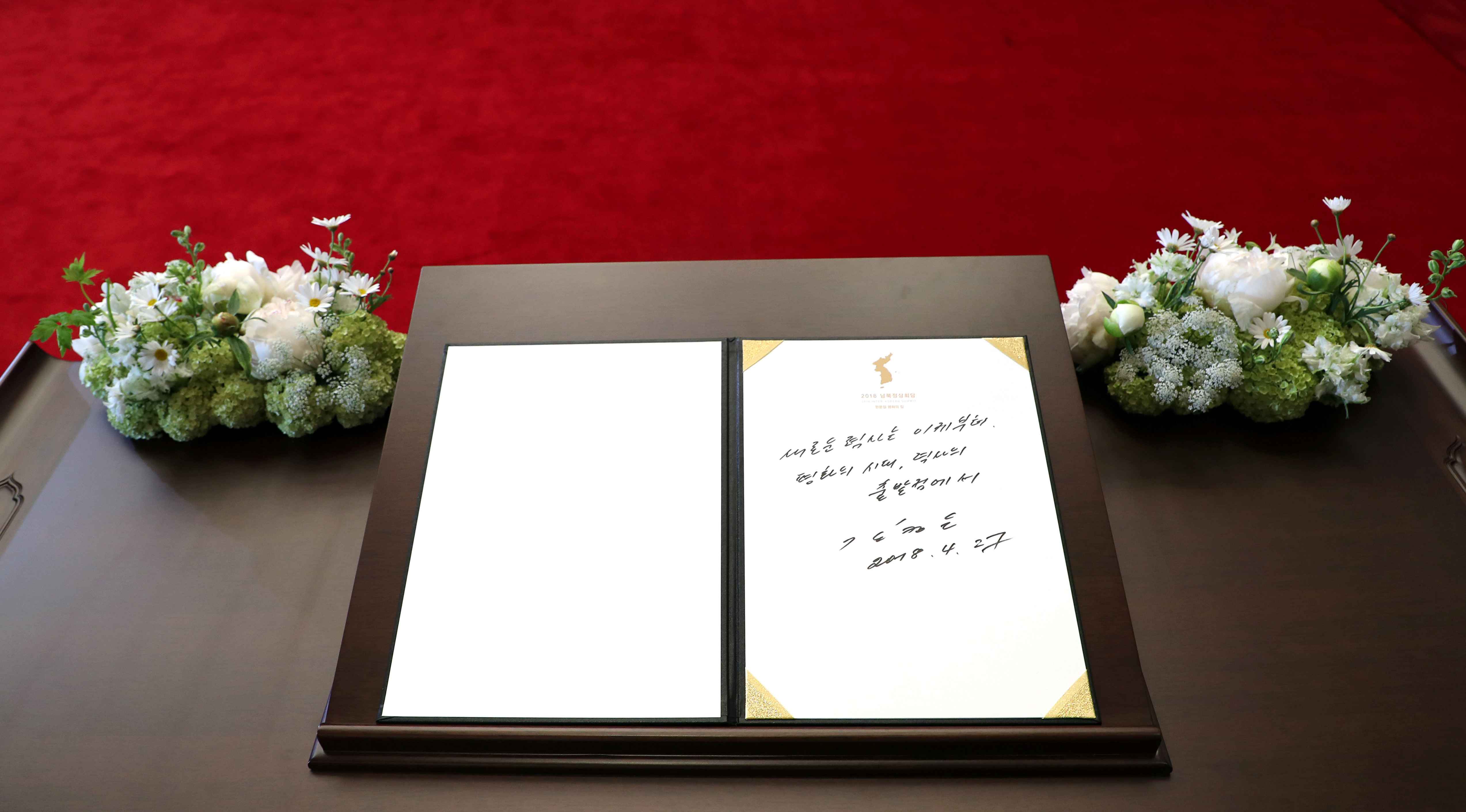 North Korean leader Kim Jong Un's entry in a guestbook at the Peace House in the demilitarized zone separating the two Koreas, South Korea, April 27, 2018. The writing reads  A new history starts now. An age of peace, from the starting point of history.