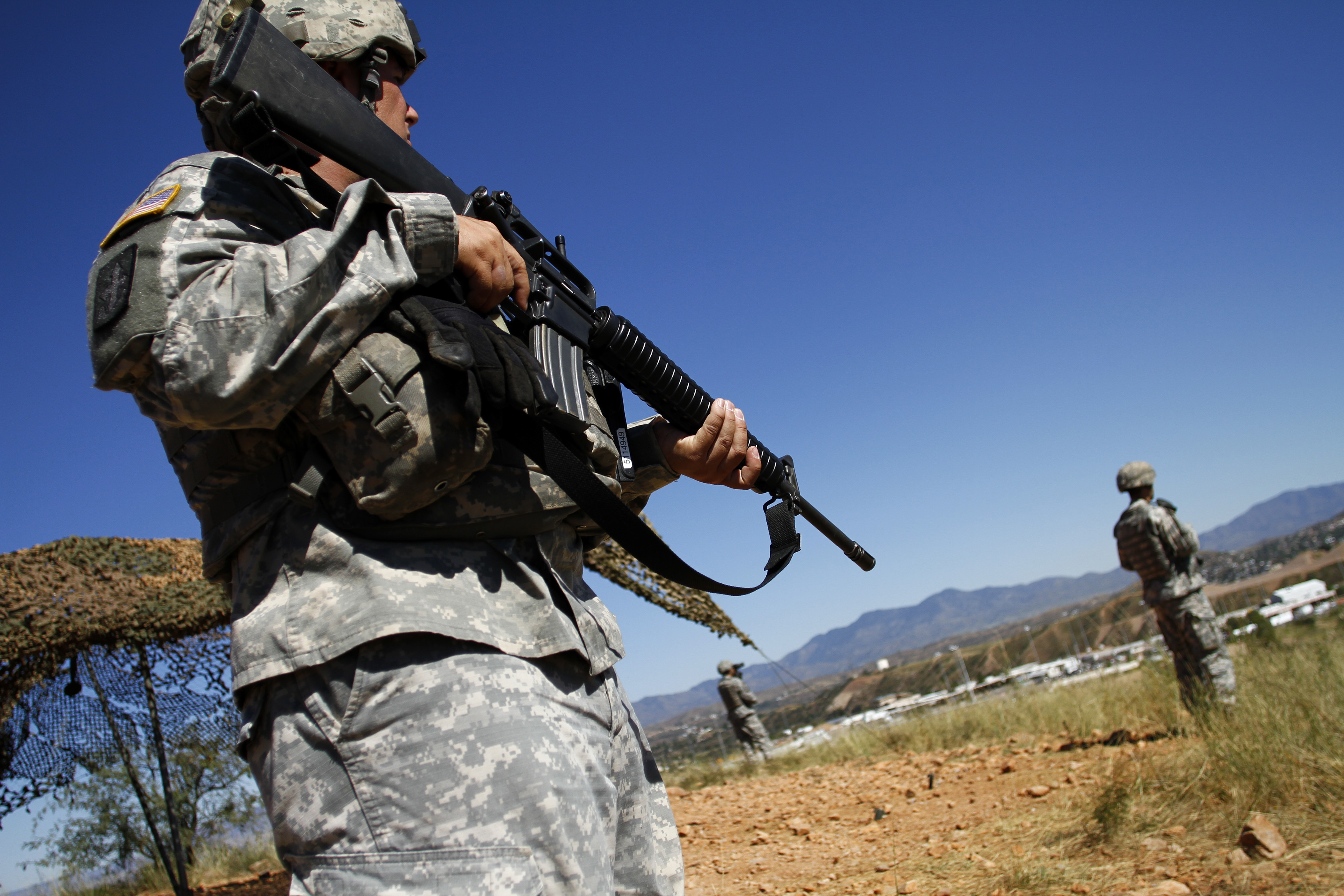U.S. National Guard troops patrol along the U.S.-Mexico border in Nogales, Ariz. on Oct. 8, 2010.