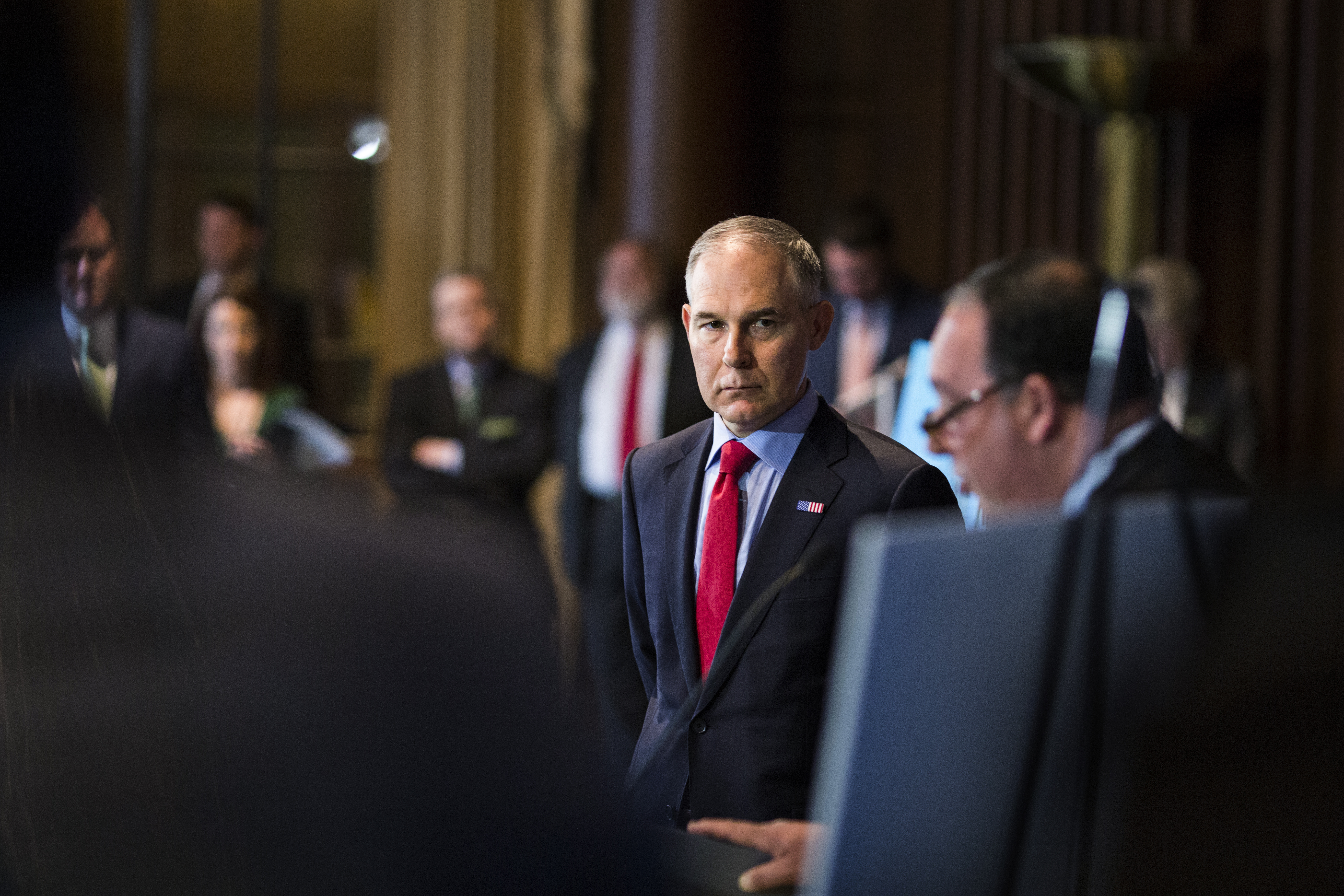 Environmental Protection Agency Administrator Scott Pruitt listens to Alliance of Automobile Manufacturers president and CEO Mitch Bainwol speak to the press at a news conference at the EPA on April 2