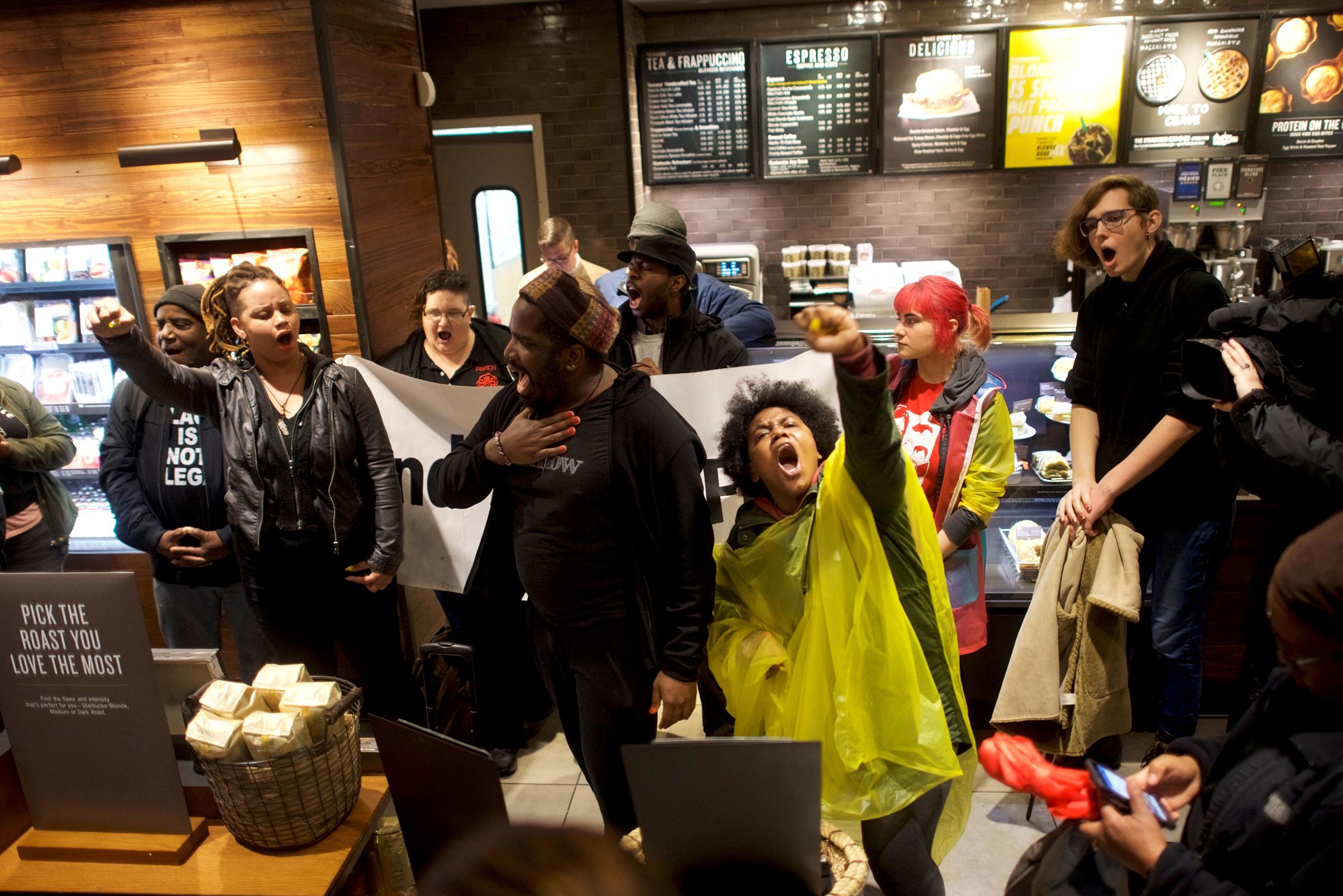 Protesters demonstrate inside a Center City Starbucks, where two black men were arrested, in Philadelphia, Pennsylvania, U.S., April 16, 2018