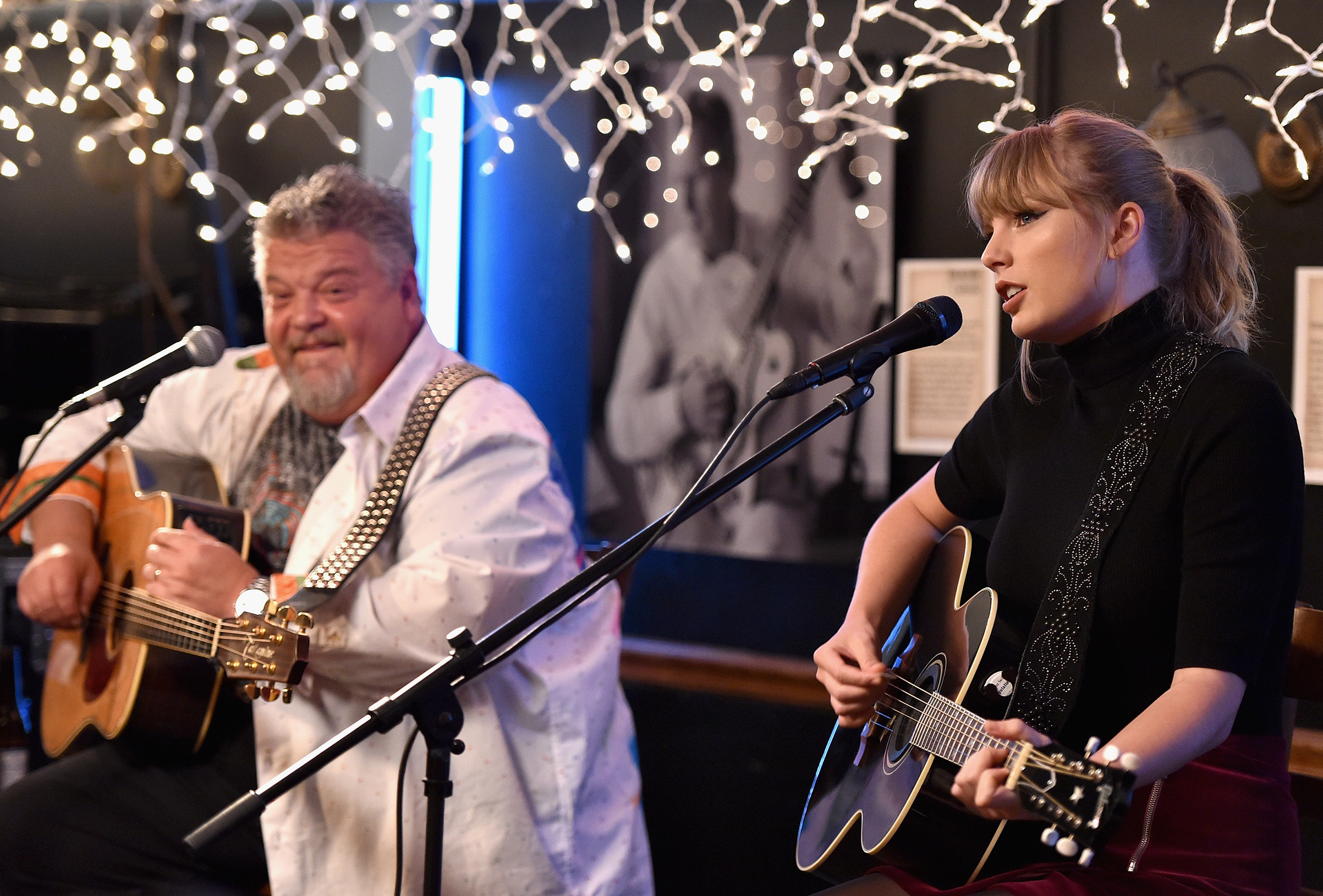 Craig Wiseman and special guest Taylor Swift perform onstage at Bluebird Cafe on March 31, 2018 in Nashville.