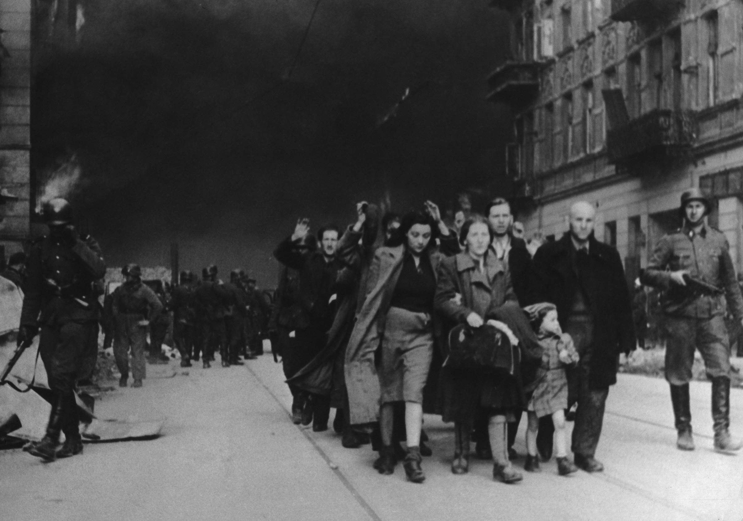 Jewish civilians are forced to march by SS soldiers in this 1943 photo during the destruction of the Warsaw Ghetto in Poland.