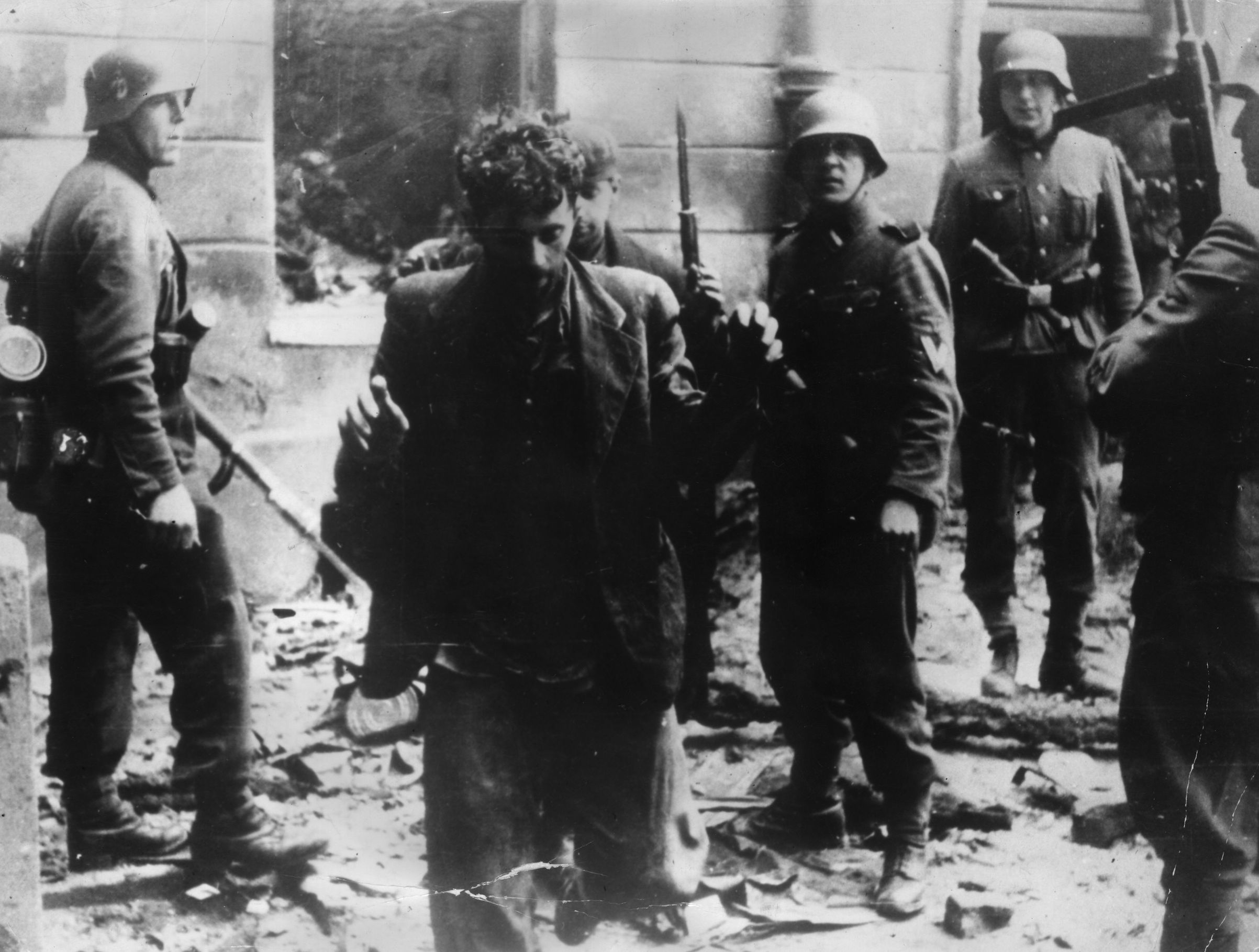 April 1943:  Two Jewish resistance fighters arrested by German troops during the Warsaw Ghetto Uprising.