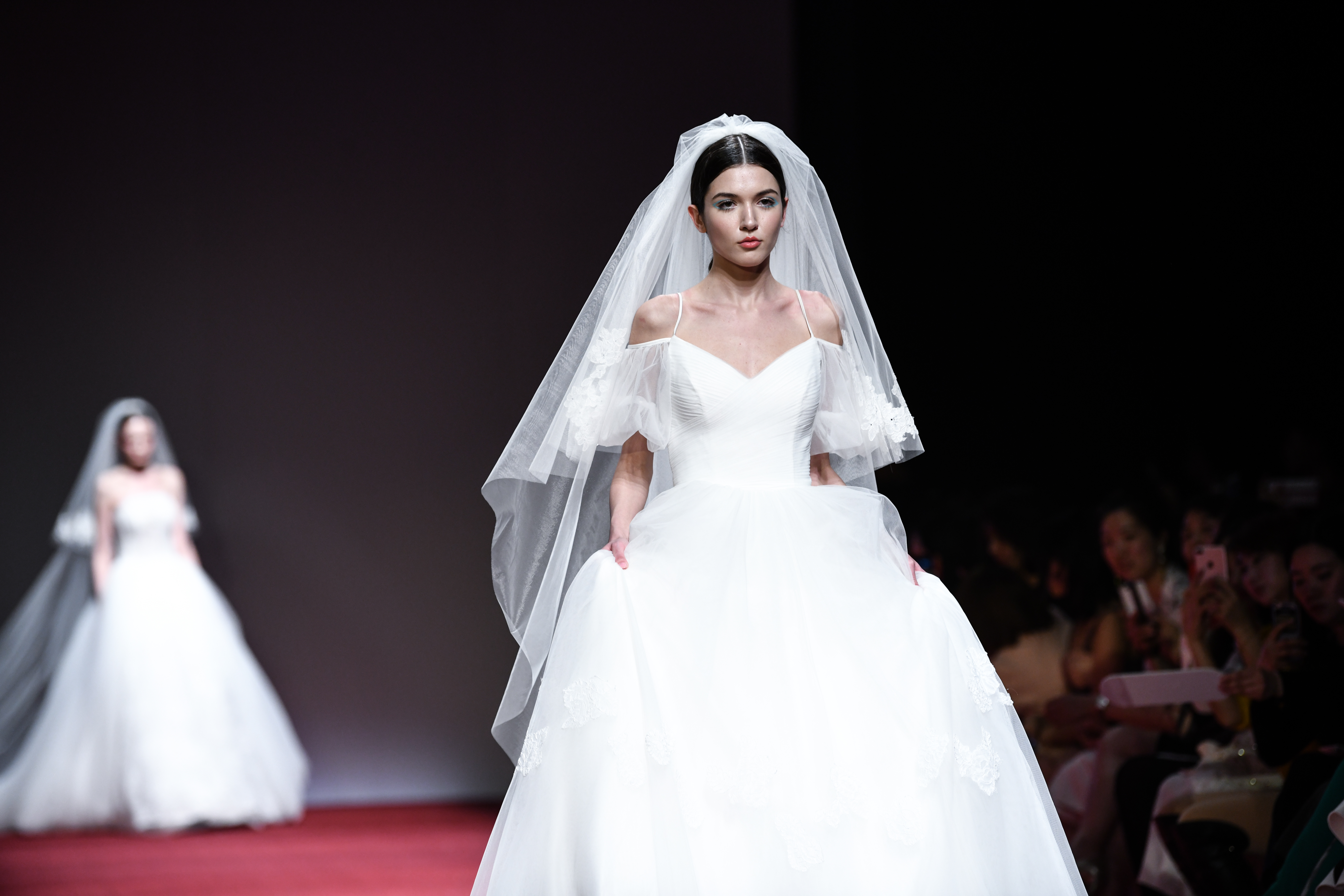 Models showcases veil designs in China