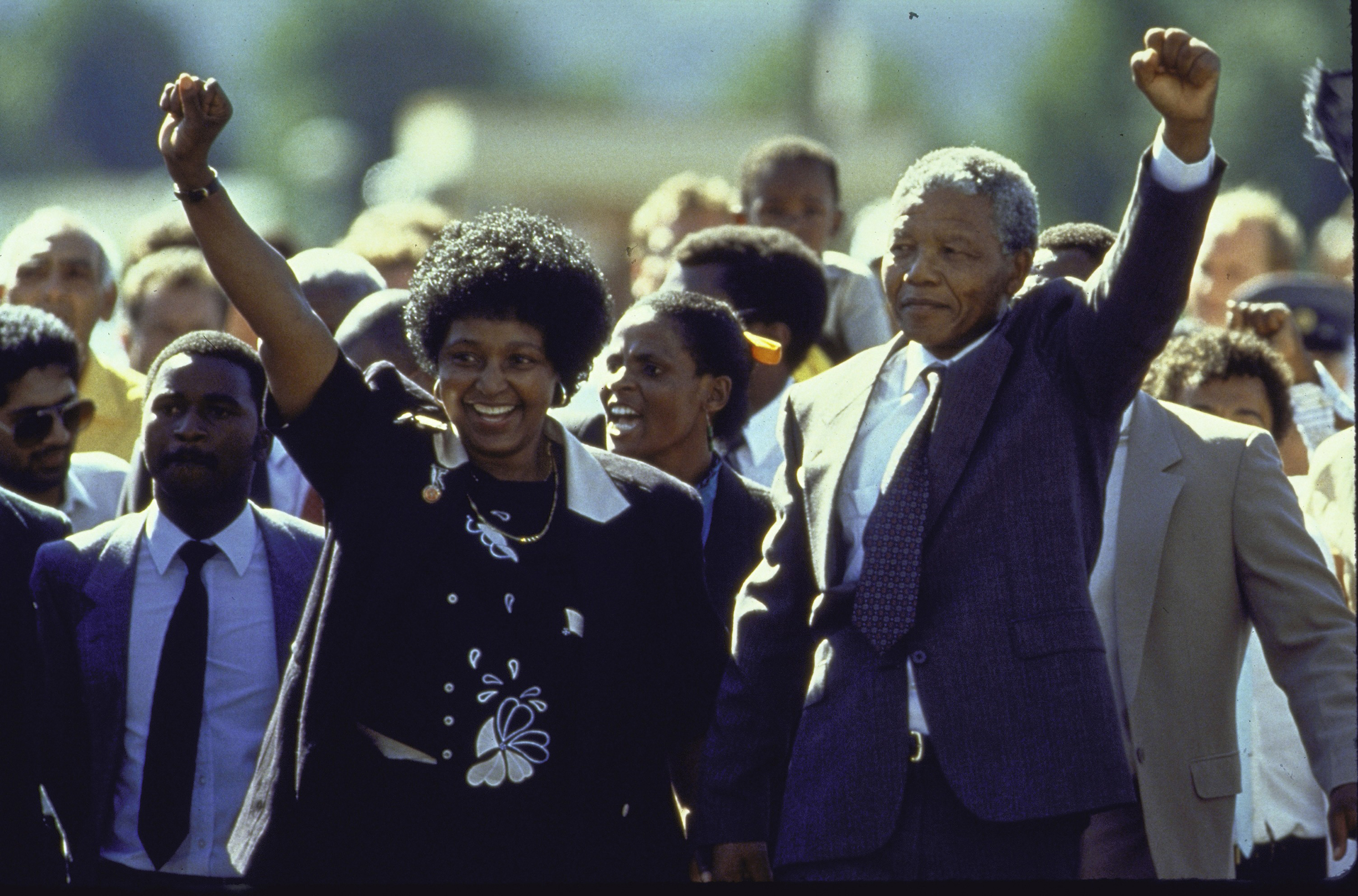 Madikizela-Mandela and her husband Nelson Mandela raise their fists in 1990 upon his release from prison after 27 years