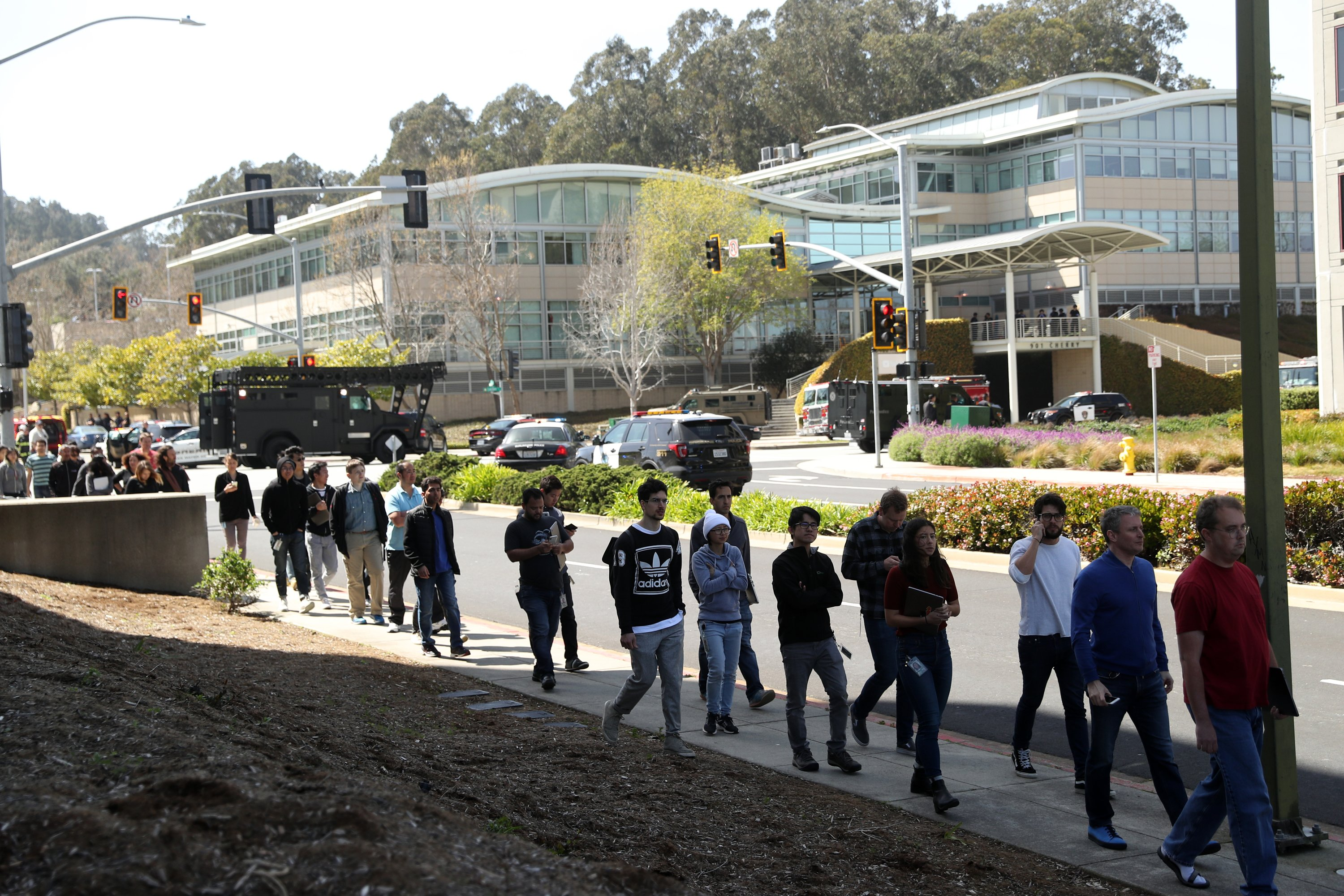 YouTube employees leave the scene after police responded to active shooter situation at YouTube facility in San Bruno.