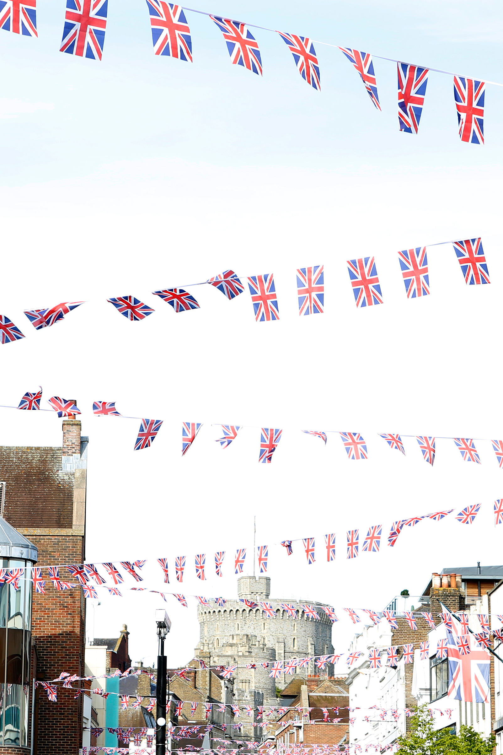 Flags criss-cross a street in Windsor, near the castle where Harry and Meghan wed.