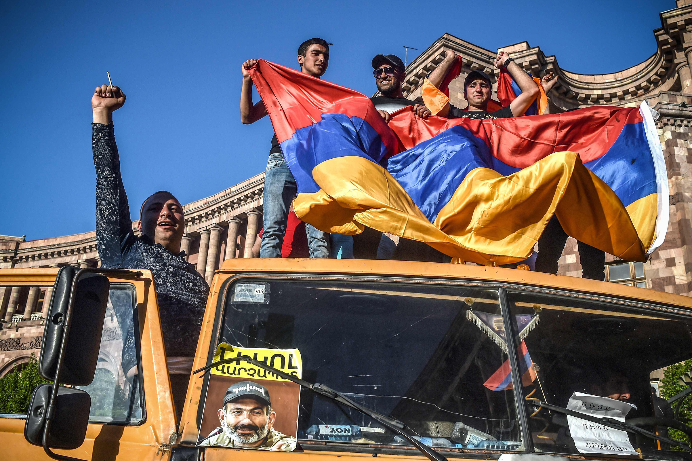 Protesters in Yerevan on May 2 wave the Armenian flag from a truck displaying a photograph of opposition leader Nikol Pashinyan, who was appointed interim Prime Minister days later