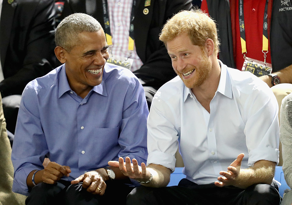 Former U.S. President Barack Obama and Prince Harry share a joke as they watch wheelchair baskeball on day 7 of the Invictus Games 2017 on September 29, 2017 in Toronto, Canada.