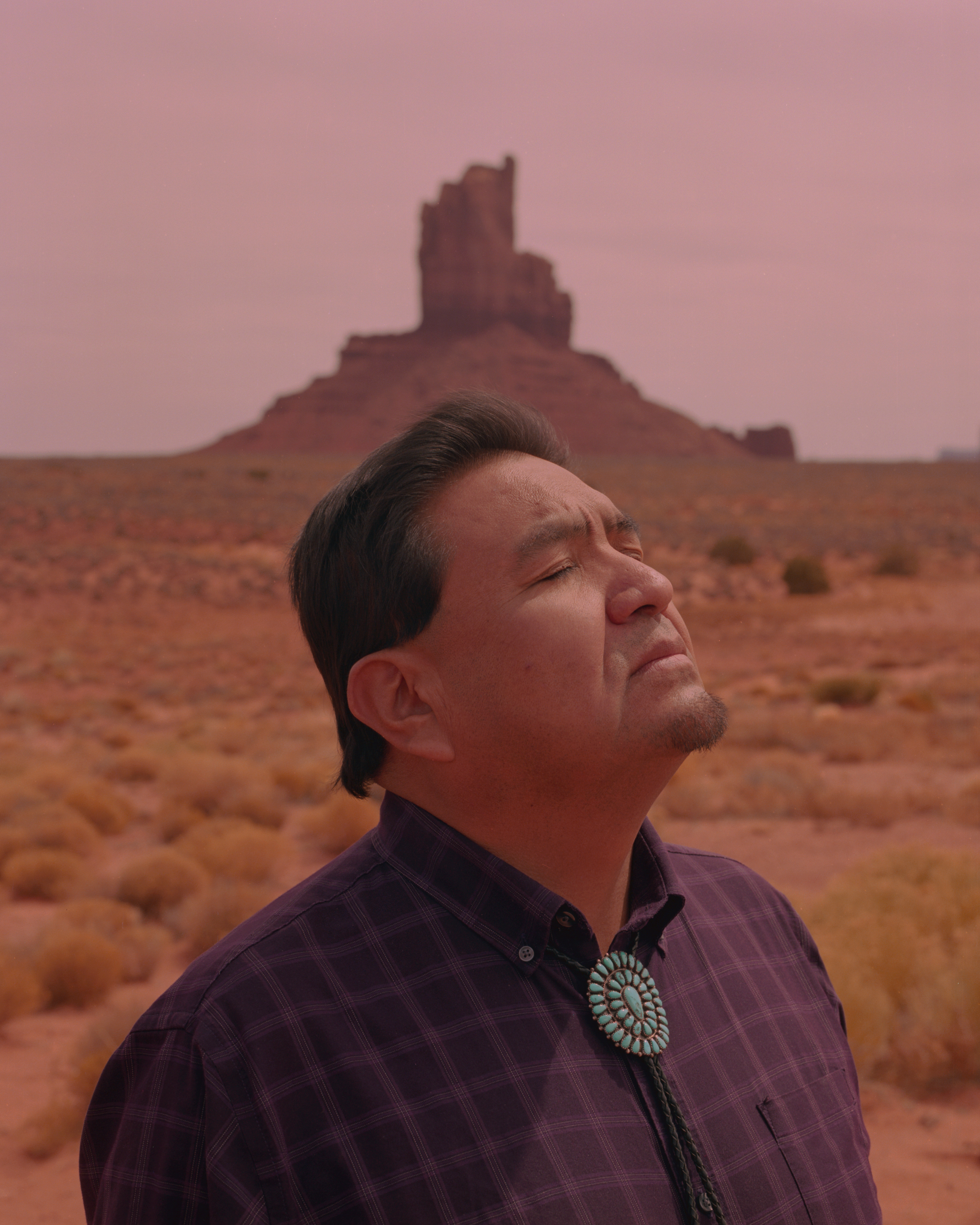 James Adakai, a Navajo tribal leader and commissioner, in front of the Big Chief Mesa in Monument Valley.Adakai was selected as commissioner of the Bears Ears Coalition to protect the land during Obama's presidency. Now residing in Window Rock, AZ, he frequently makes hour long trips to Monument Valley and Bears Ears for meetings and efforts towards the fight to protect the land.