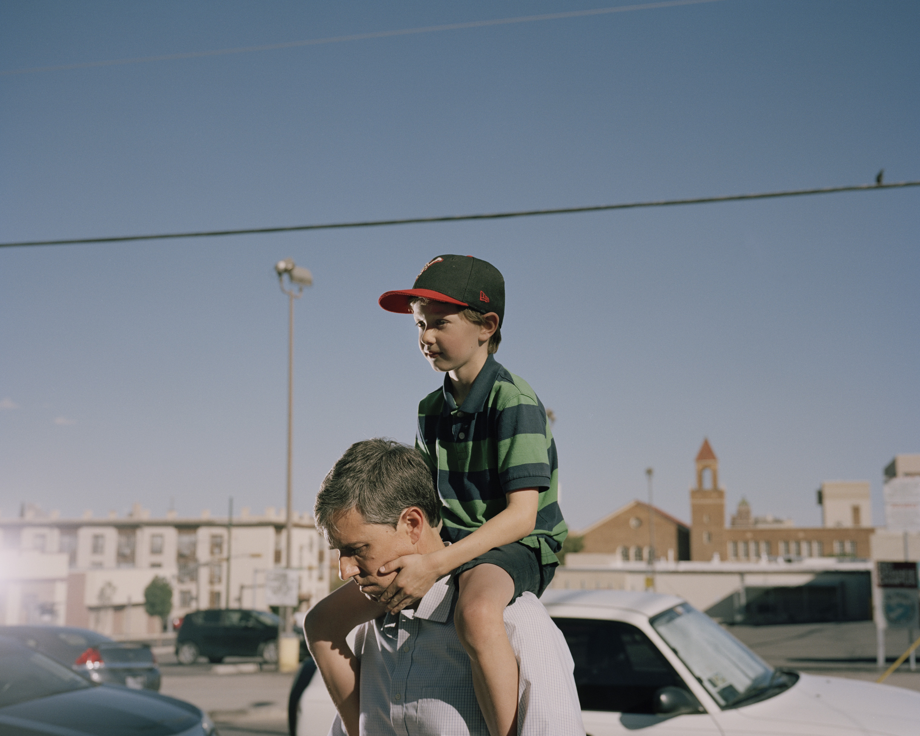 O'Rourke carries his son Henry, 7, on his shoulders.