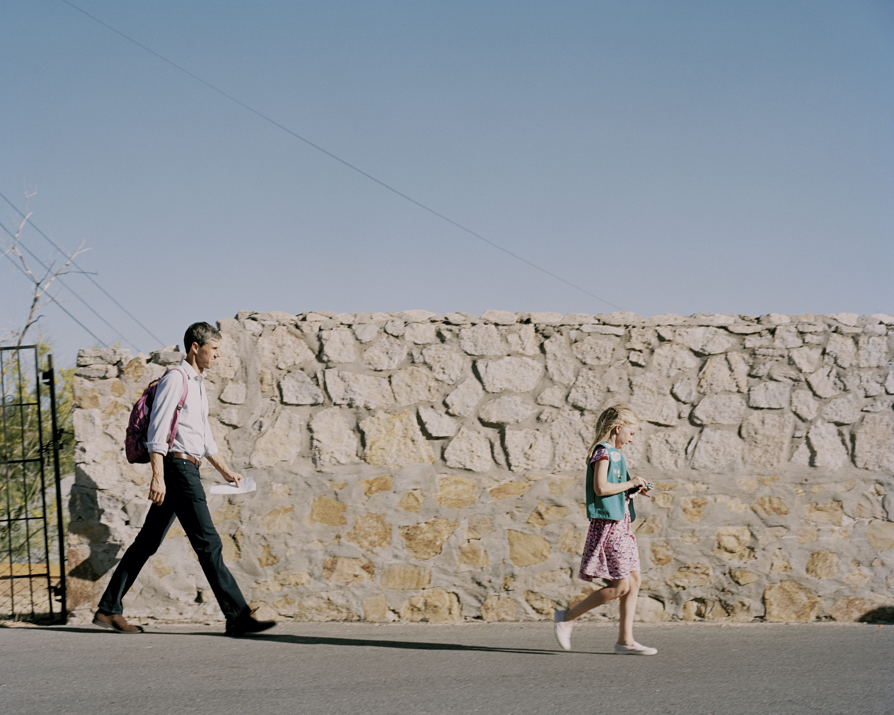 O'Rourke walks home with his daughter Molly, 9, after a poetry slam held by his daughter's Girl Scout troop.