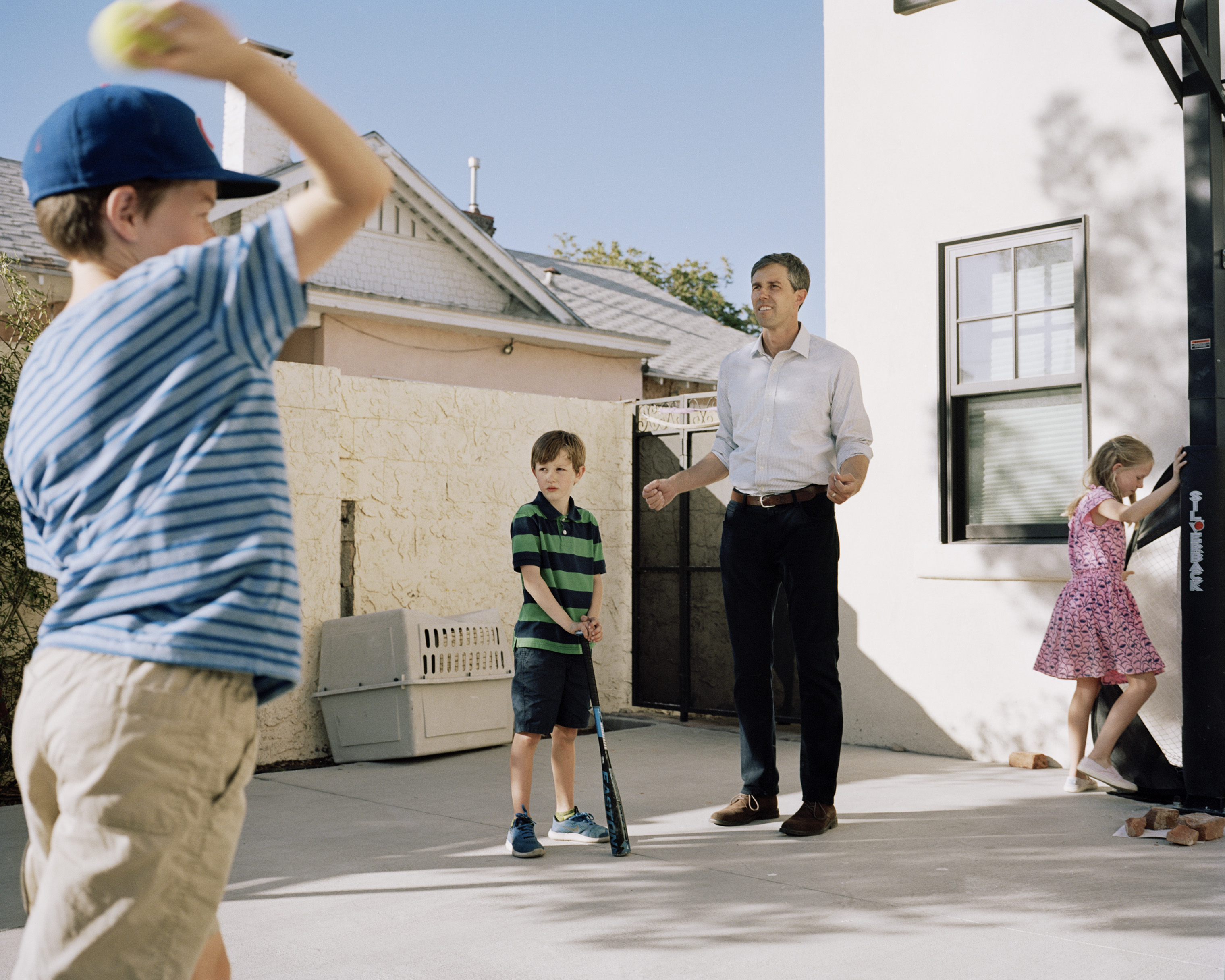 O'Rourke plays with his kids outside of his home.