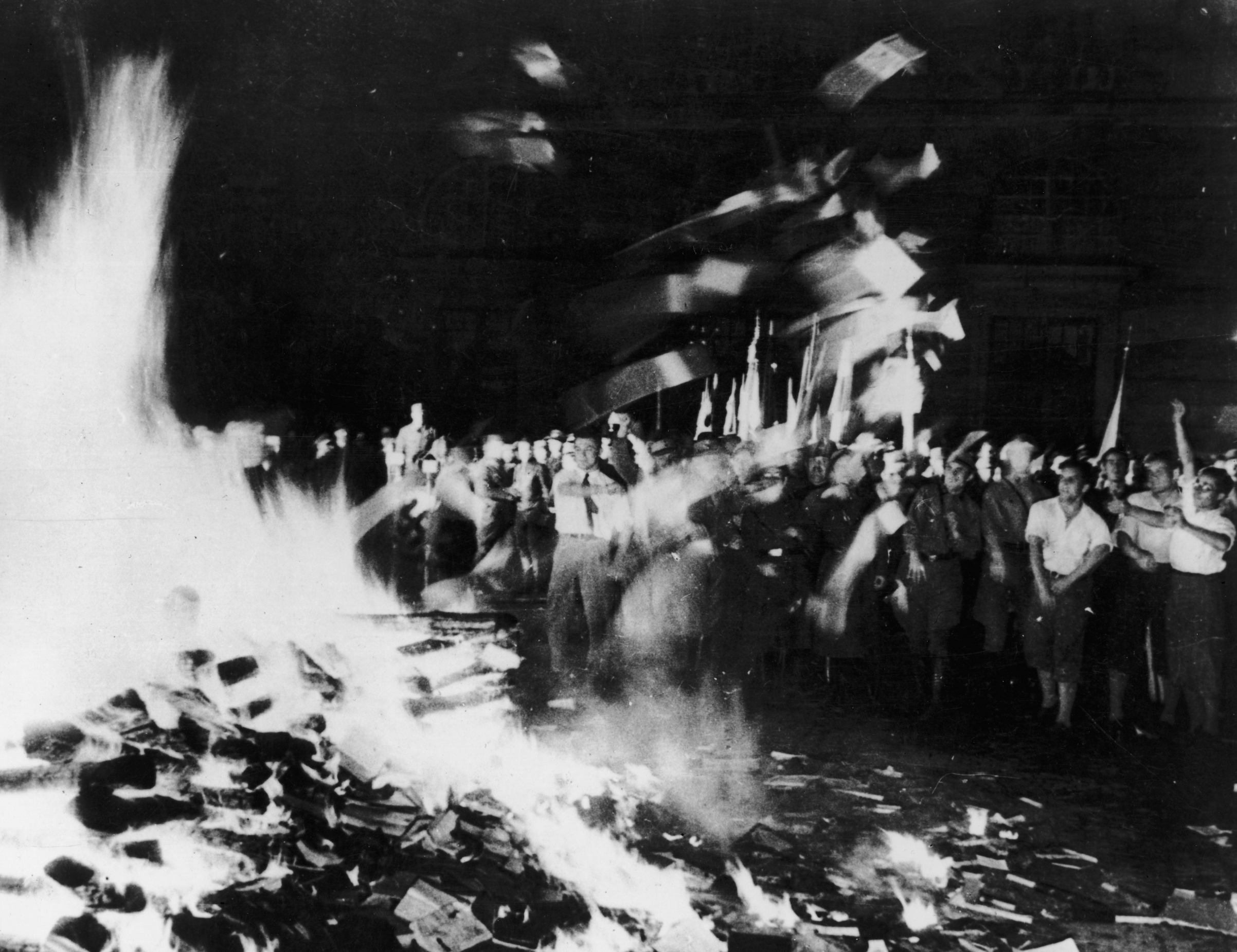 Nazis and students burn books on a huge bonfire of 'anti-German' literature in the Opernplatz, Berlin, in 1933.