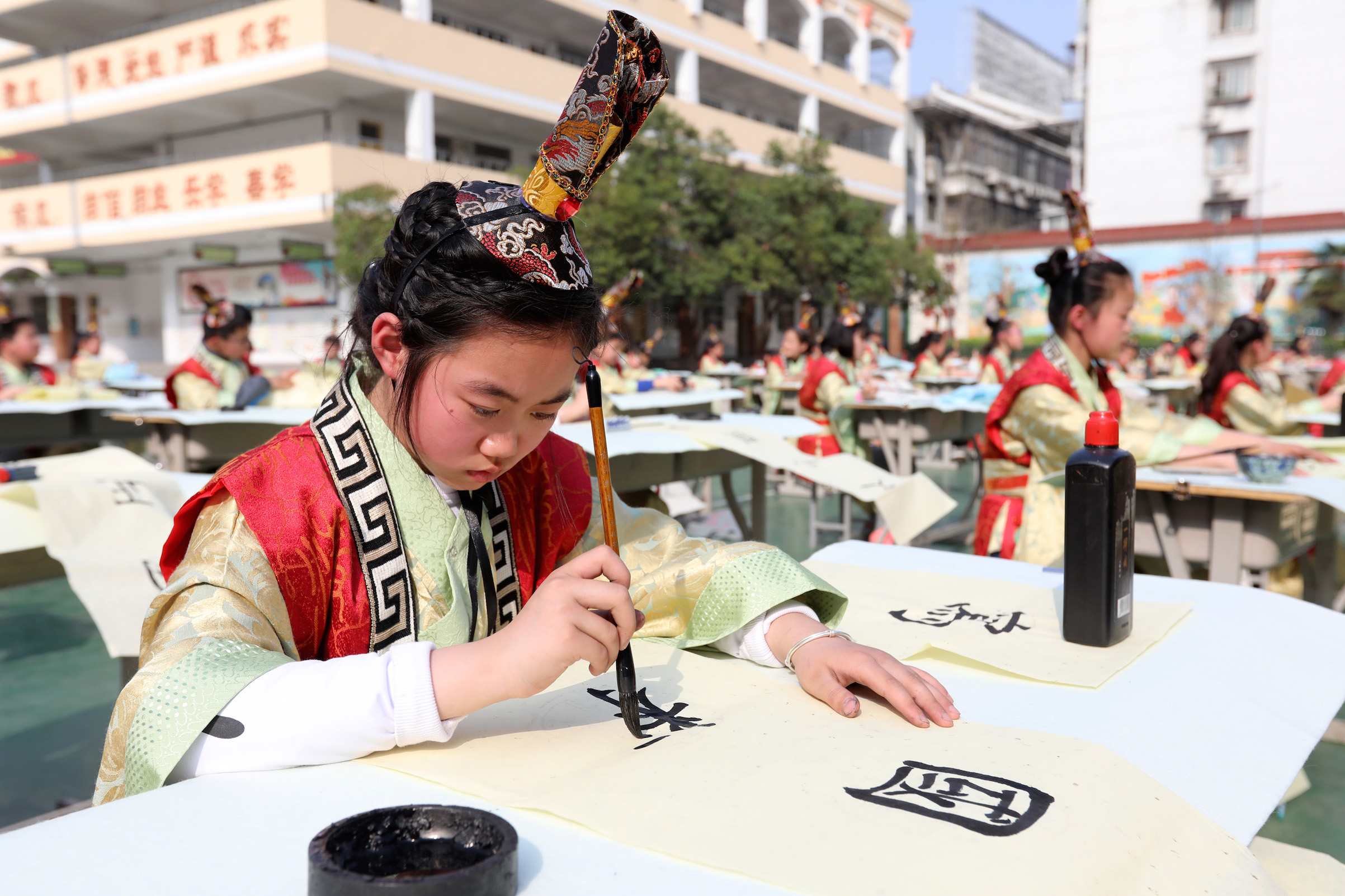 Students of Huaibei City Gucheng Road Primary School attend a calligraphy competition on March 30, 2018, in Huaibei, Anhui Province of China.