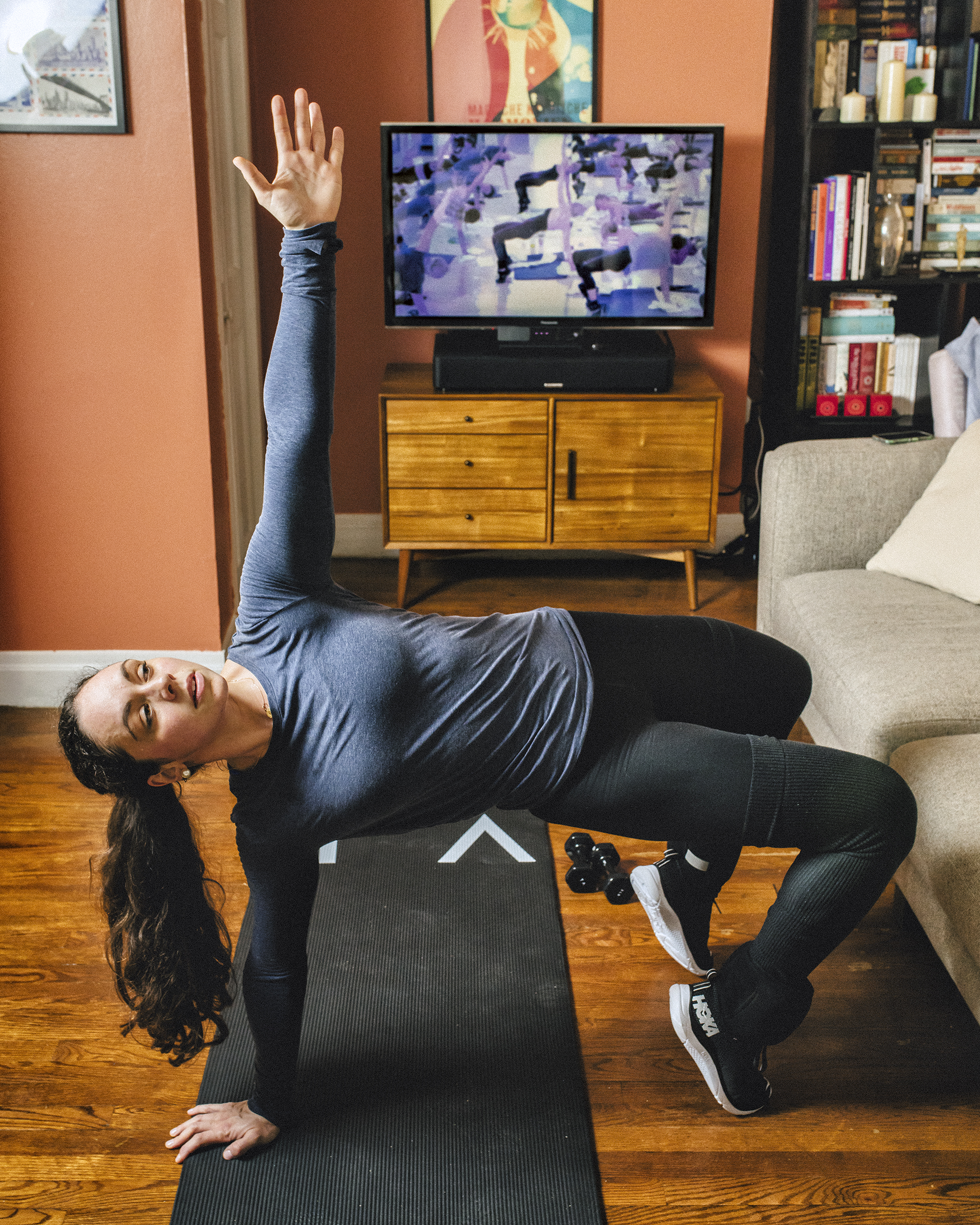 Camille MacFadyen works out in her living room to Tracy Anderson's weekly streaming fitness class. Since having her daughter, MacFadyen has been doing more exercise at her home in the SoHo neighborhood of New York City. CREDIT: Bryan Derballa for TIME