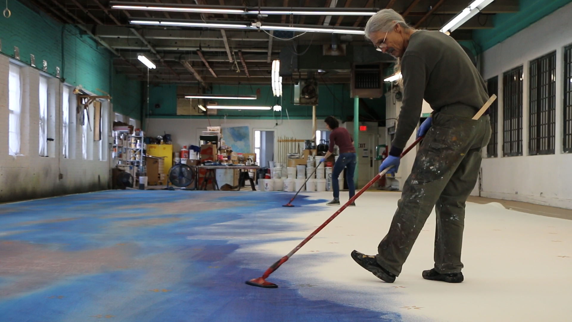 An Artist at work on a backdrop at Scenic Arts Studio