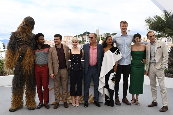 Chewbacca, US actor Donald Glover, US actor Alden Ehrenreich, British actress Emilia Clarke, US actor Woody Harrelson, British actress Thandie Newton, Finnish actor Joonas Suotamo, British actress Phoebe Waller-Bridge and British actor Paul Bettany pose on May 15, 2018 during a photocall for the film 'Solo : A Star Wars Story' at the 71st edition of the Cannes Film Festival in Cannes, southern France.