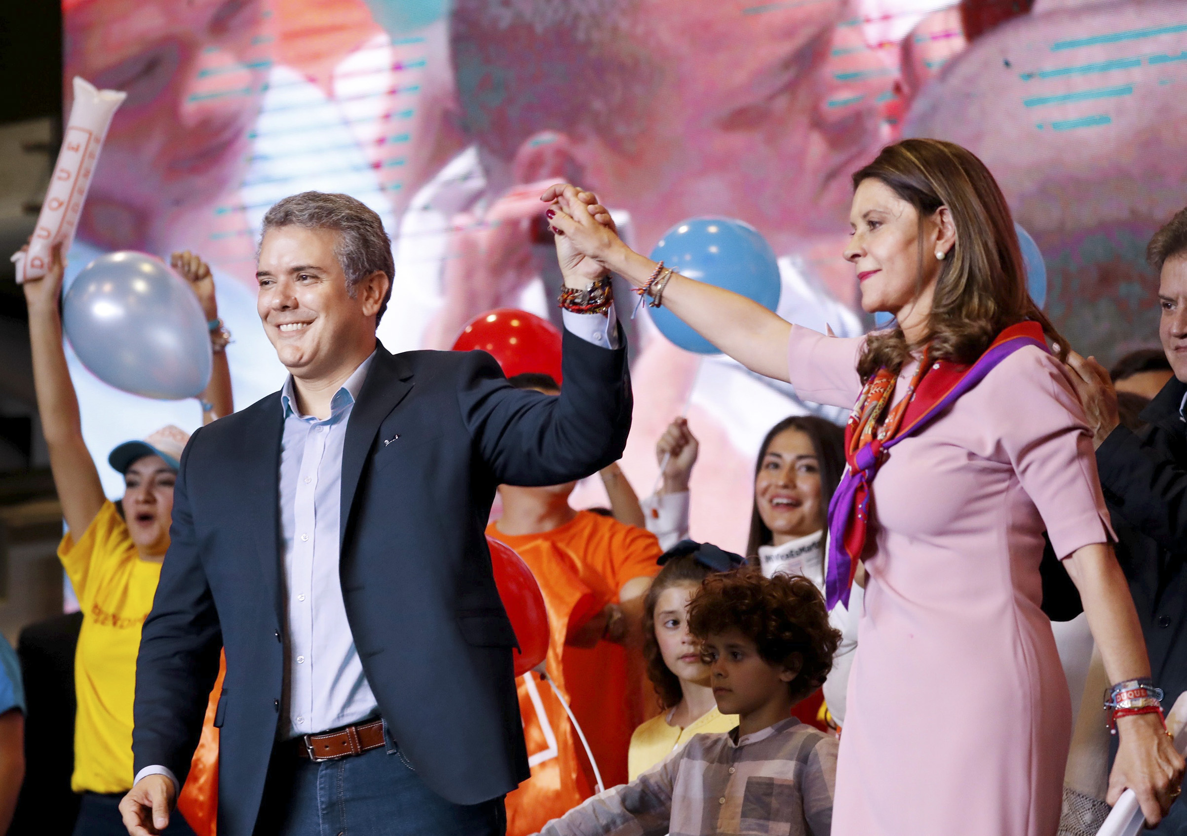 Iván Duque and his vice-presidential pick, Marta Lucía Ramírez, celebrate election success on May 27