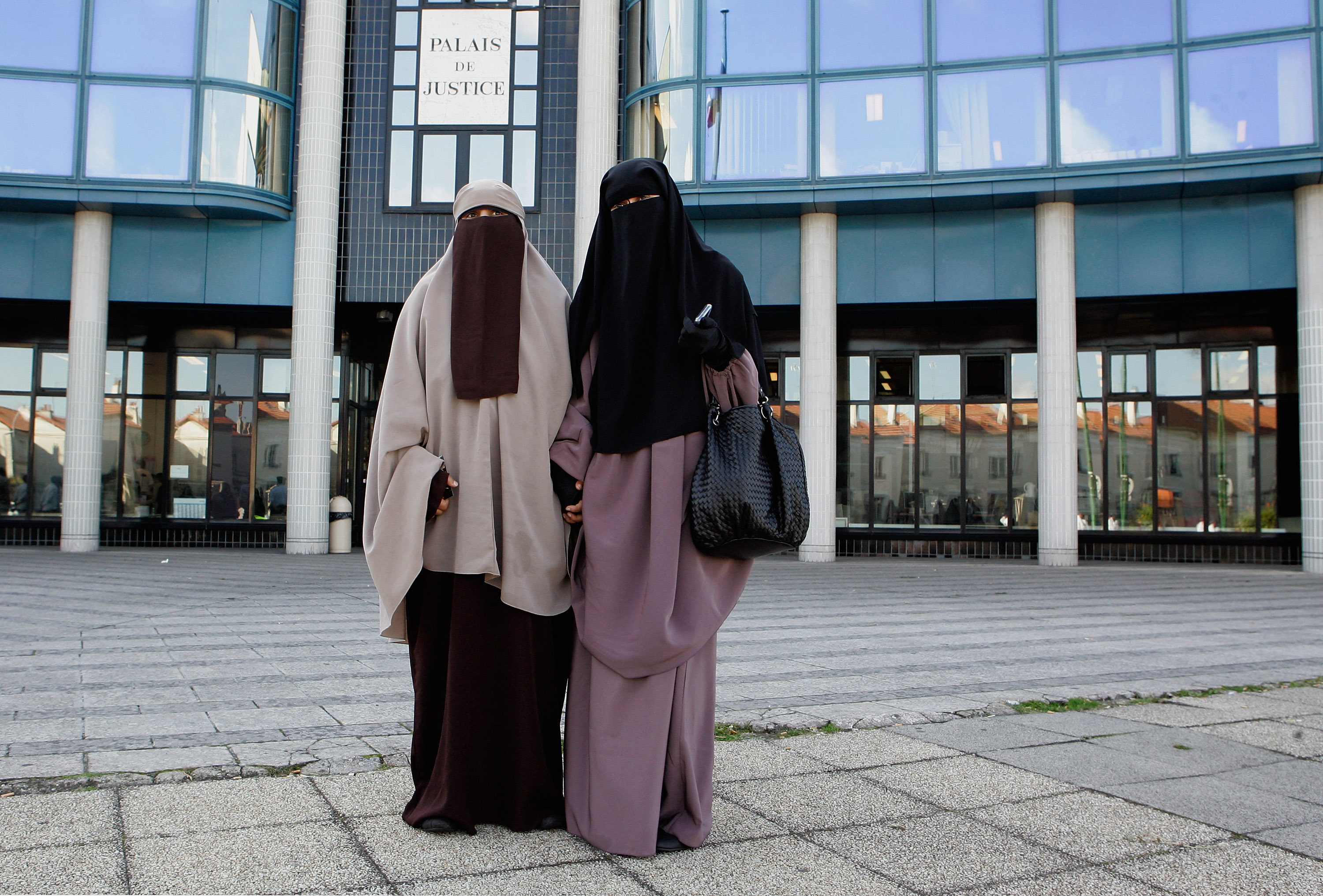 Hind Ahmas, 32, (R) stands with Kenza Drider, 32, as she leaves the court after being convicted as the first woman wearing a niqab after France's nationwide ban on the wearing of face veils on Sept. 22, 2011 in Meaux, France.