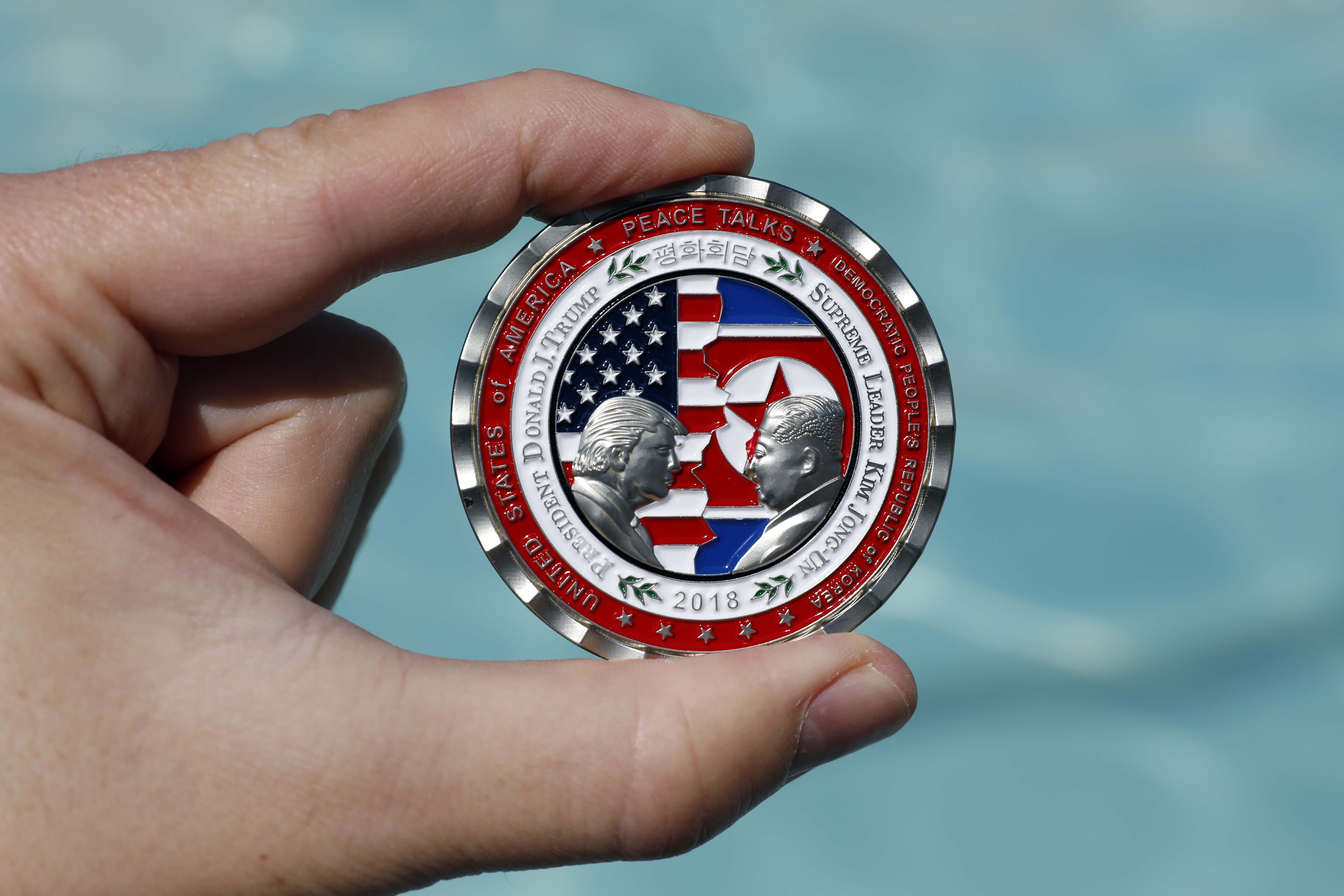 A commemorative coin released by the White House for a potential  peace summit,  featuring the names and silhouettes of U.S. President Donald Trump and North Korean leader Kim Jung Un.